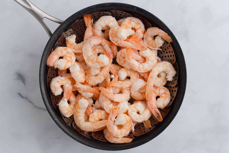 shrimp in a steamer basket, in a saucepan