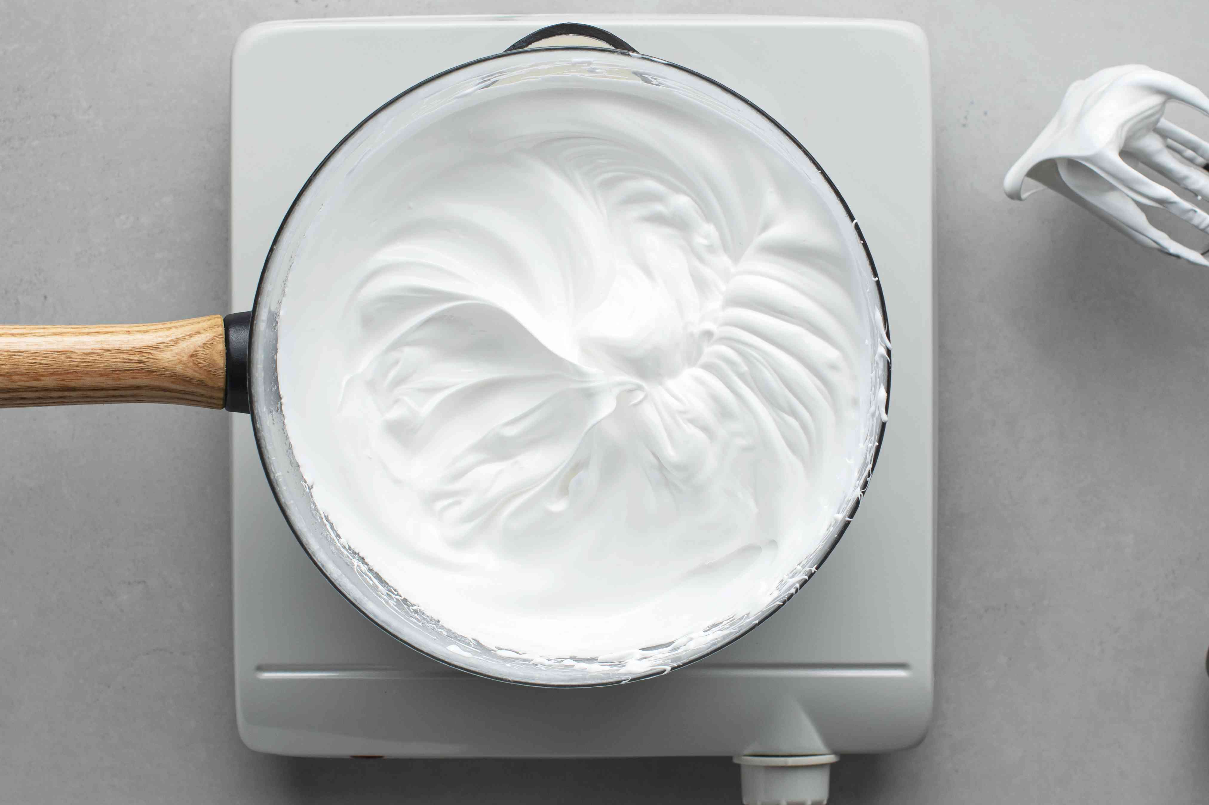 beat egg whites mixture with a hand mixer over a double boiler