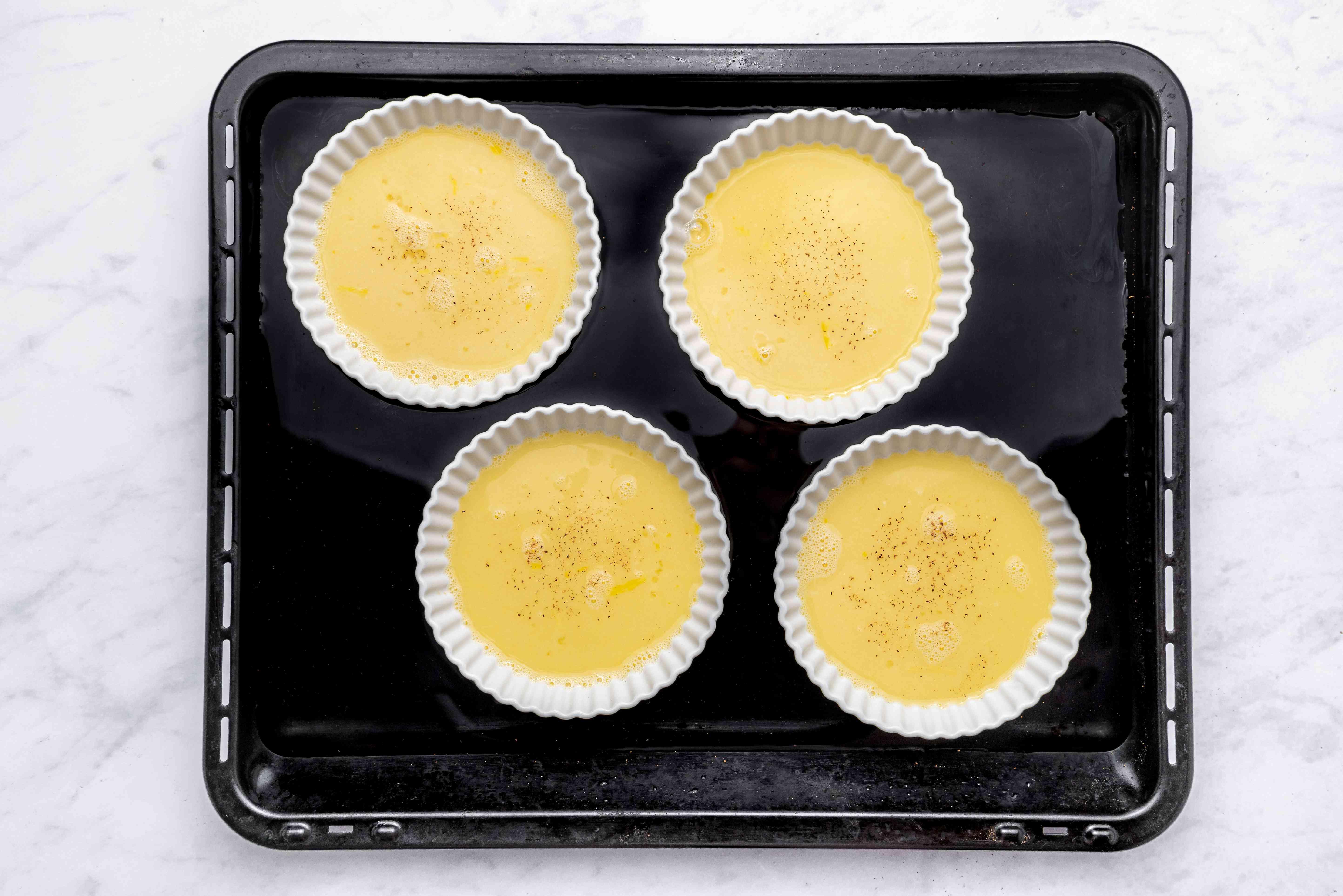 custard in ramekins, sprinkled with nutmeg