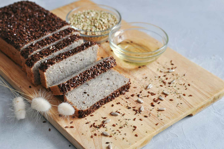 Homemade bread on sourdough of green buckwheat with flax seeds, sunflower.
