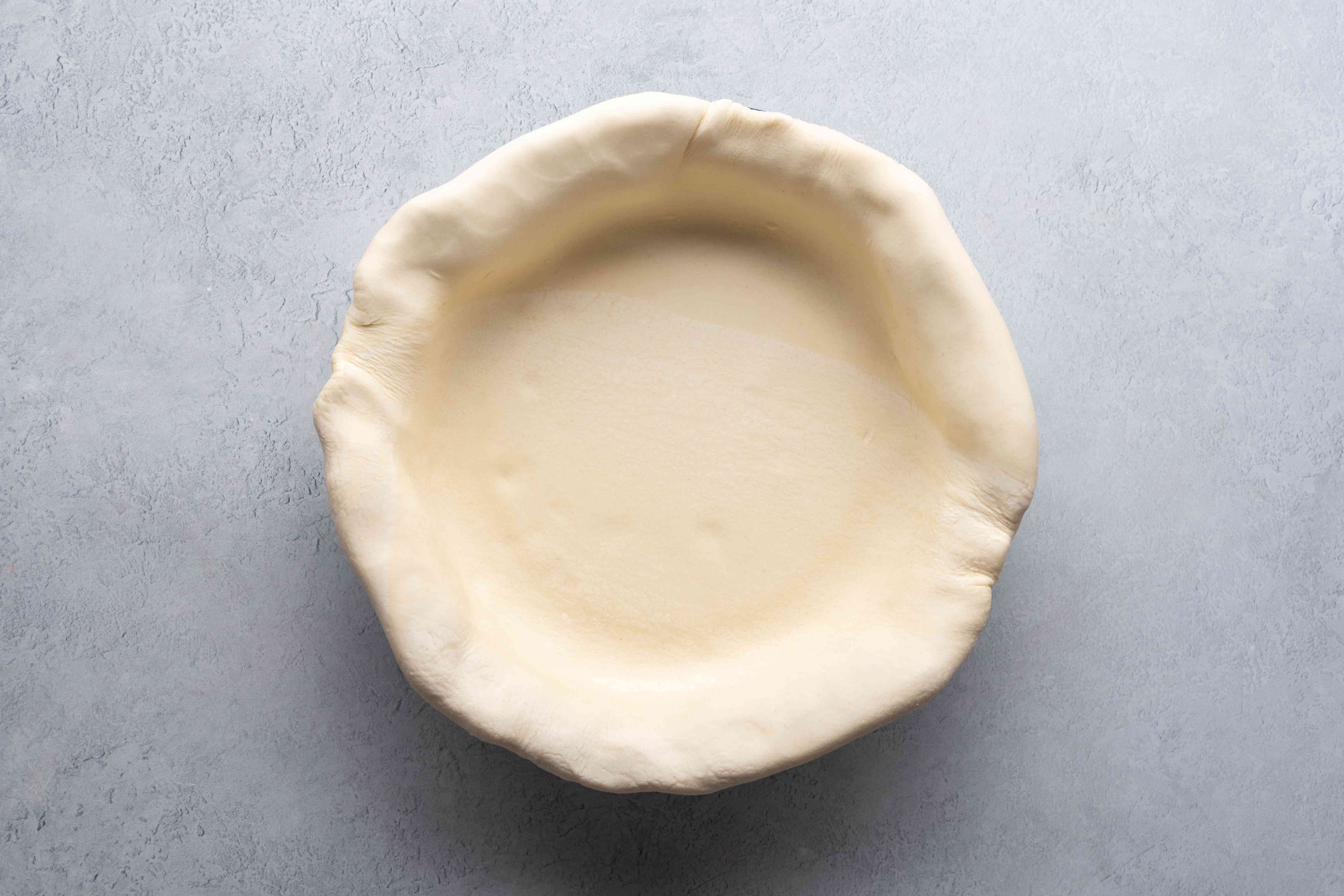 Fold over the sides to fit the tart pan and create an edge
