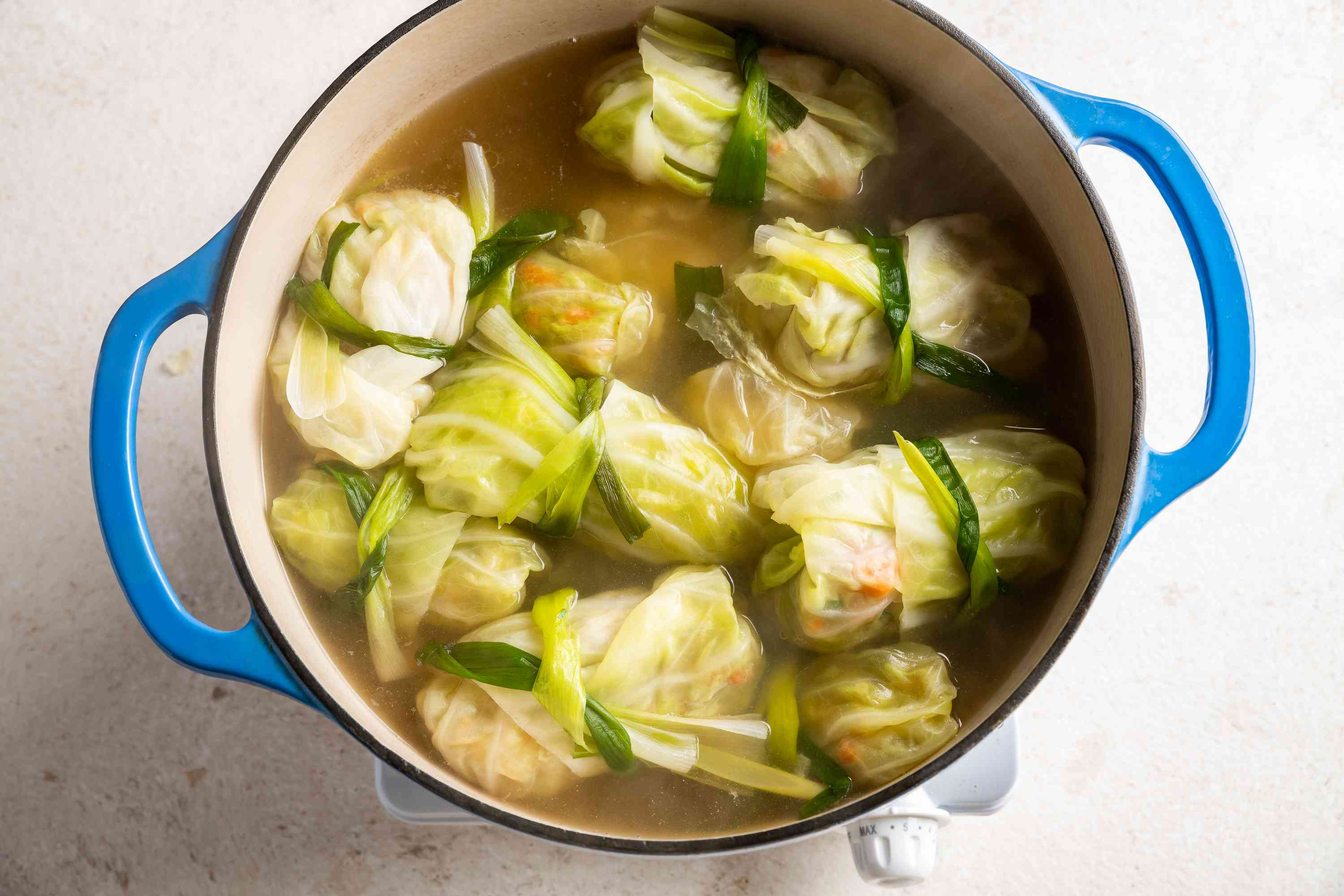 Canh Bap Cai Nhoi Thit (Vietnamese Cabbage Rolls Soup) in a pot with broth
