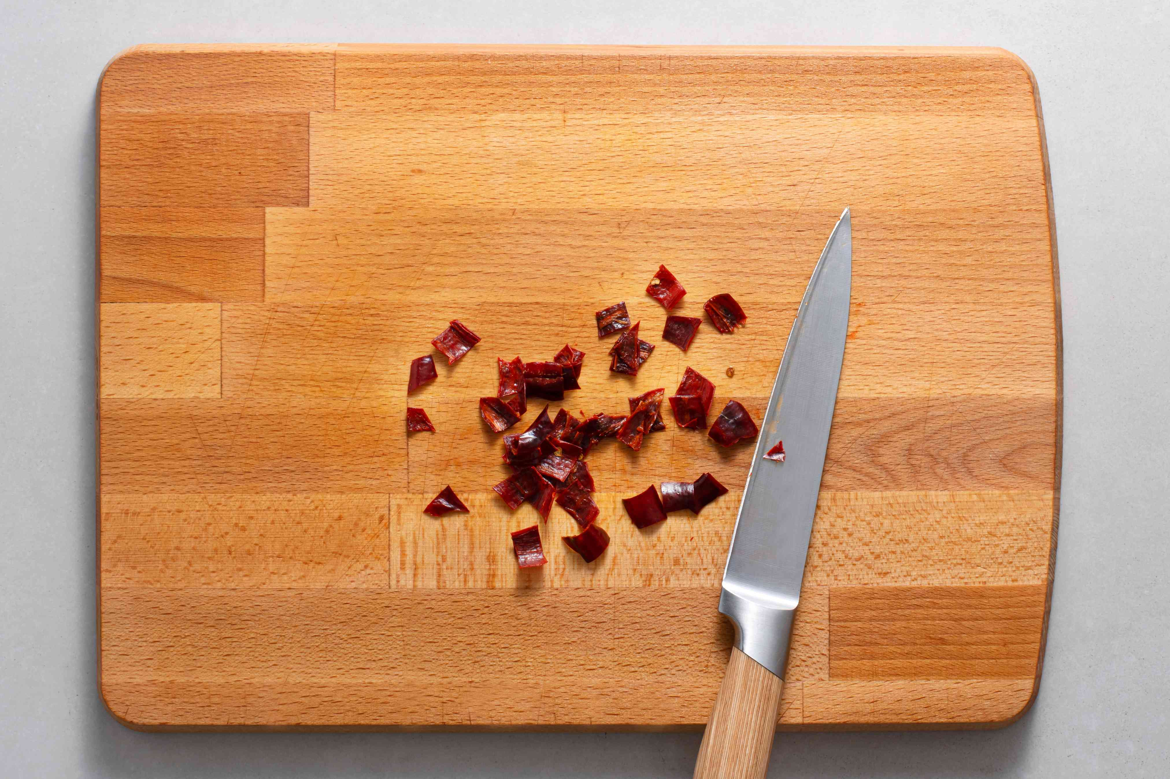 diced red chile on a cutting board