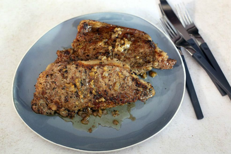Pan broiled steak drizzled in bourbon sauce