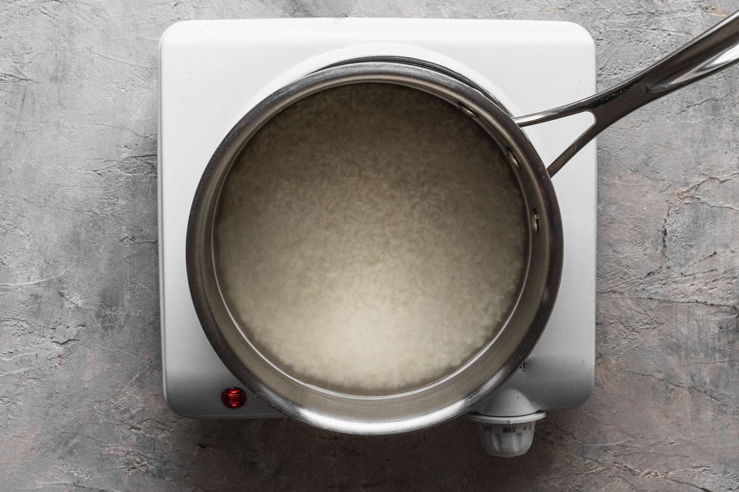 rice and water in a saucepan