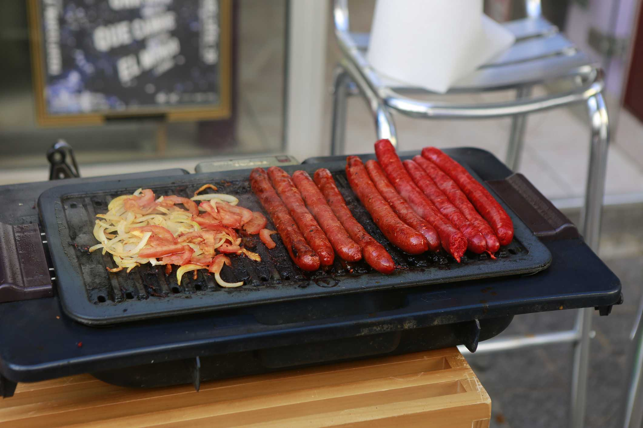 Merguez sausages on a grill