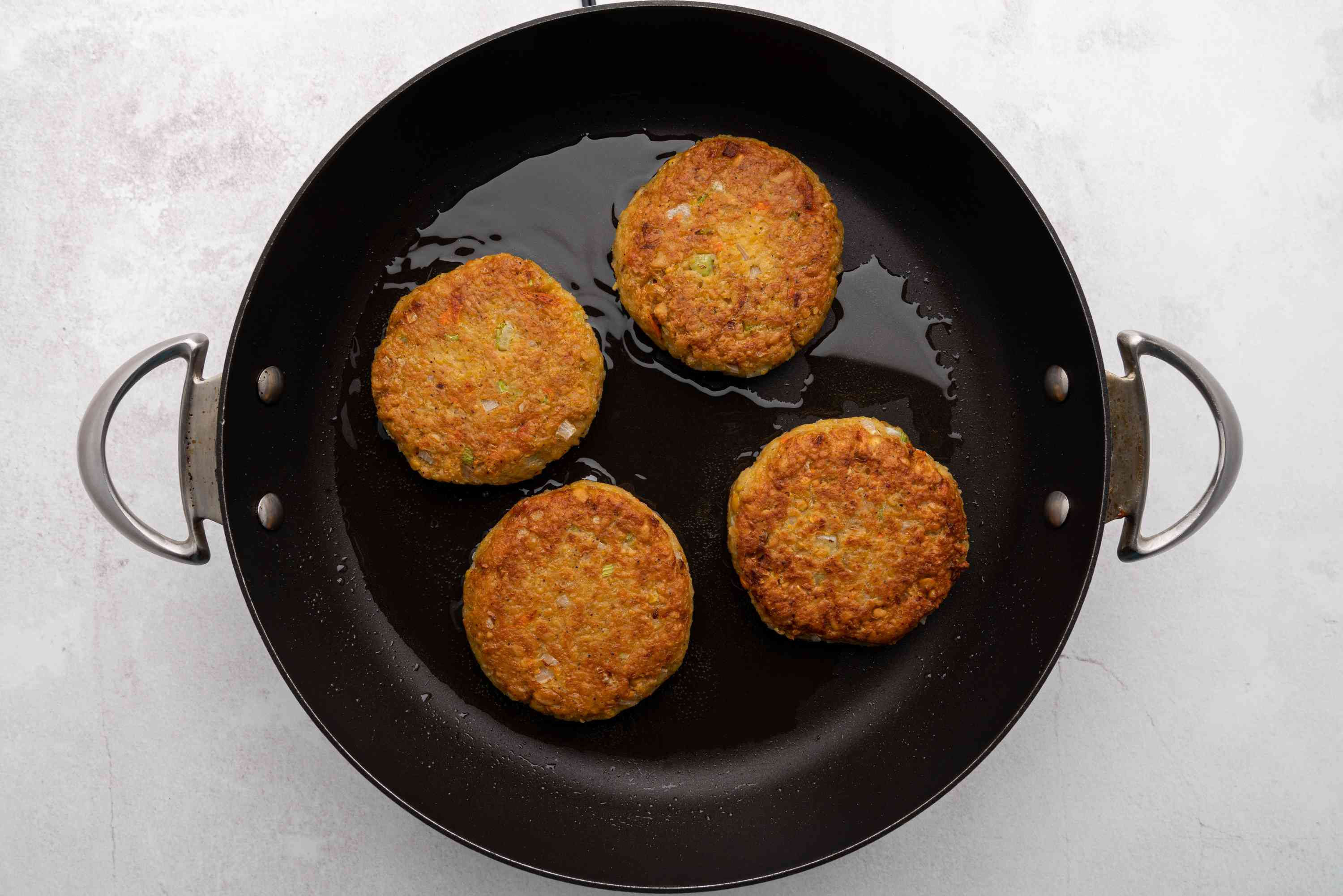 chickpea patties frying in a skillet