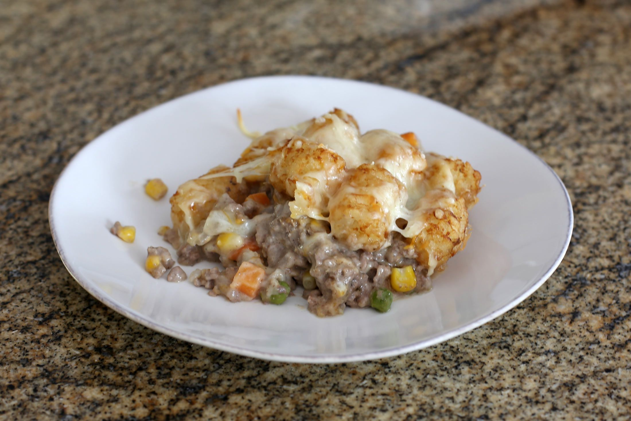 This Tater Tot casserole is our kid's ALL TIME FAVORITE meal and we love it too! It is SO easy to throw together and its a good one to let little ones help with.