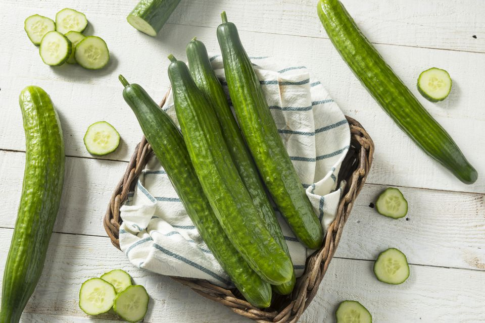 English cucumbers in basket and cut up