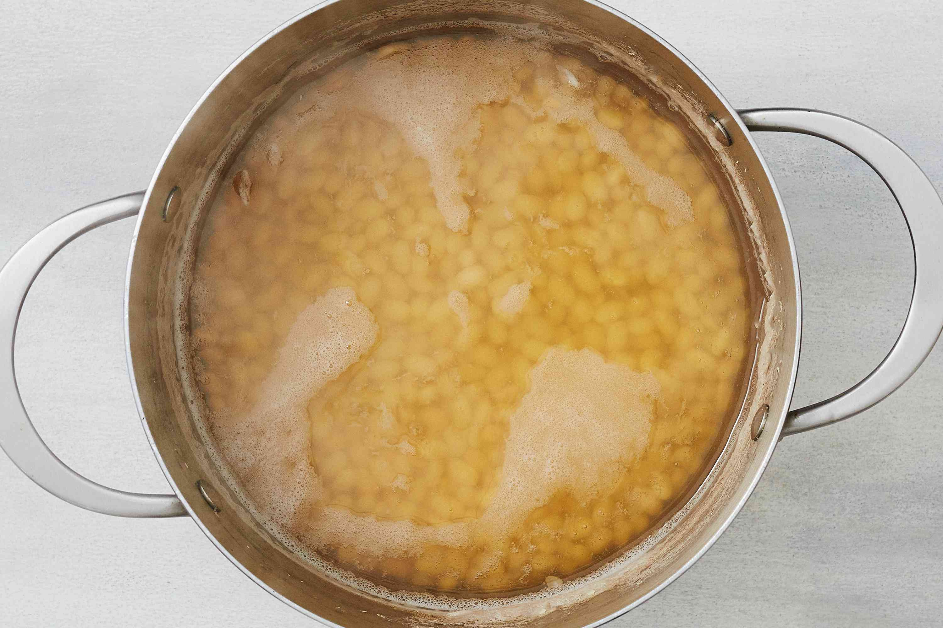 water and beans in a pot