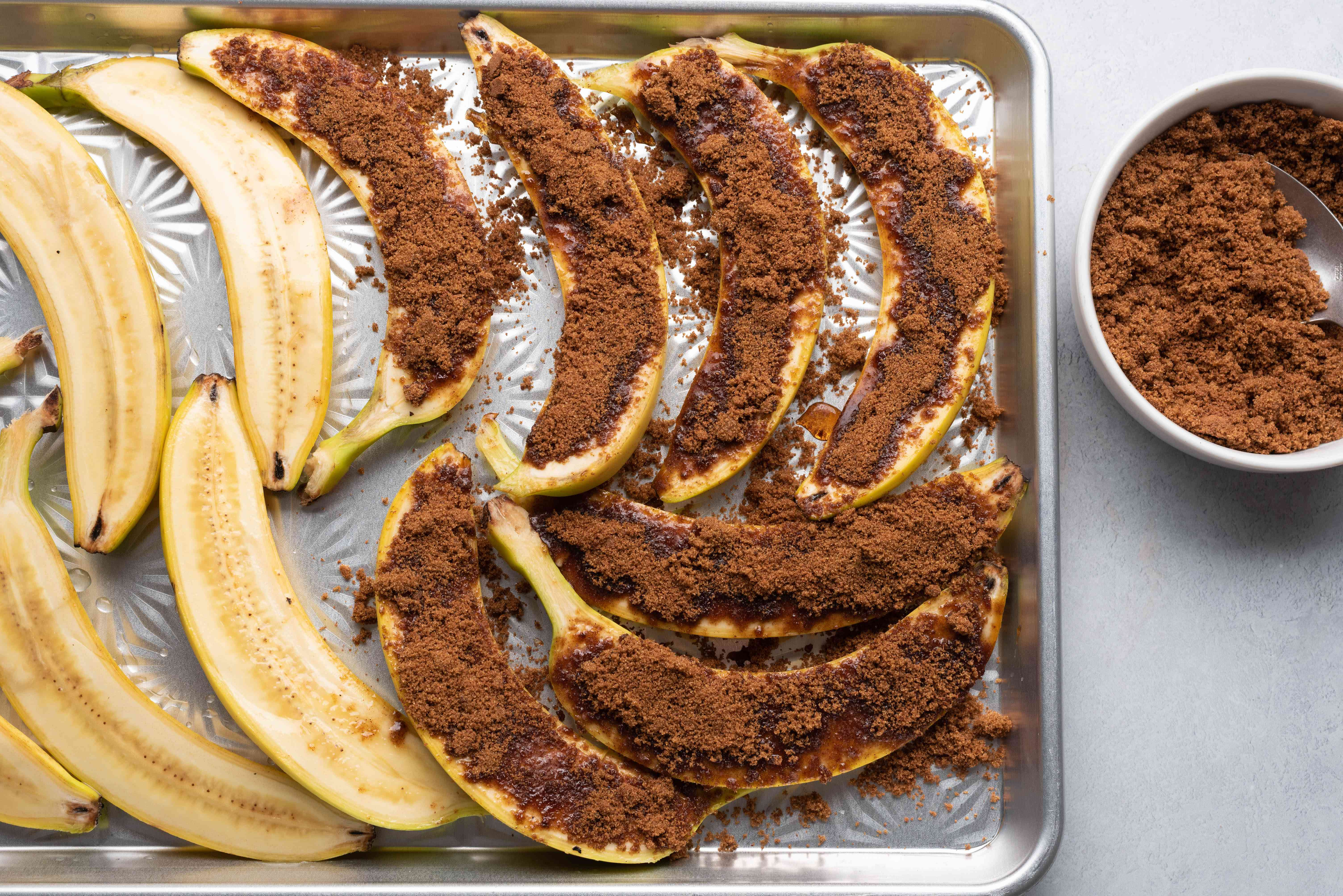 Coat the exposed surface of the bananas in the sugar mixture