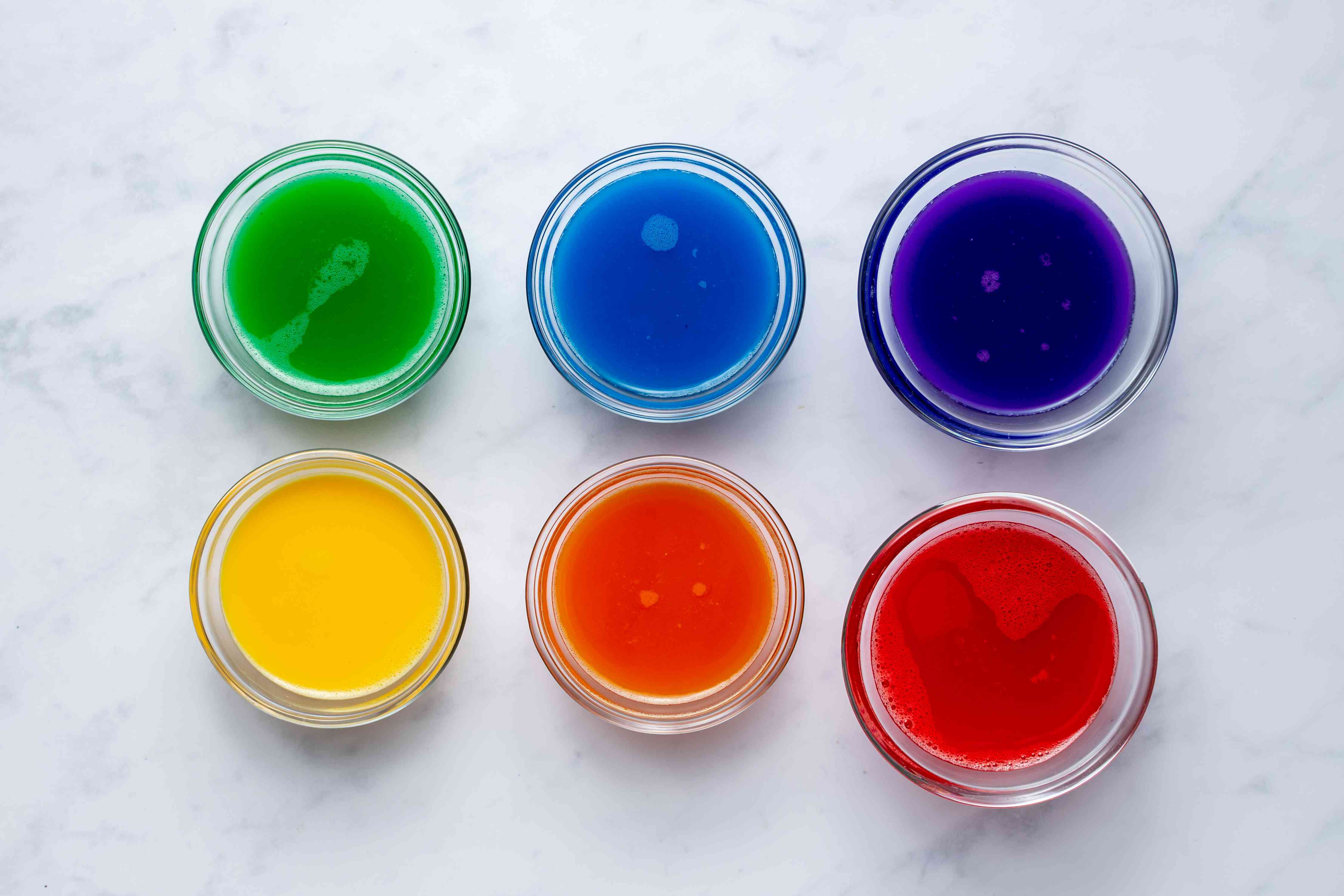 gelatin and food coloring in bowls