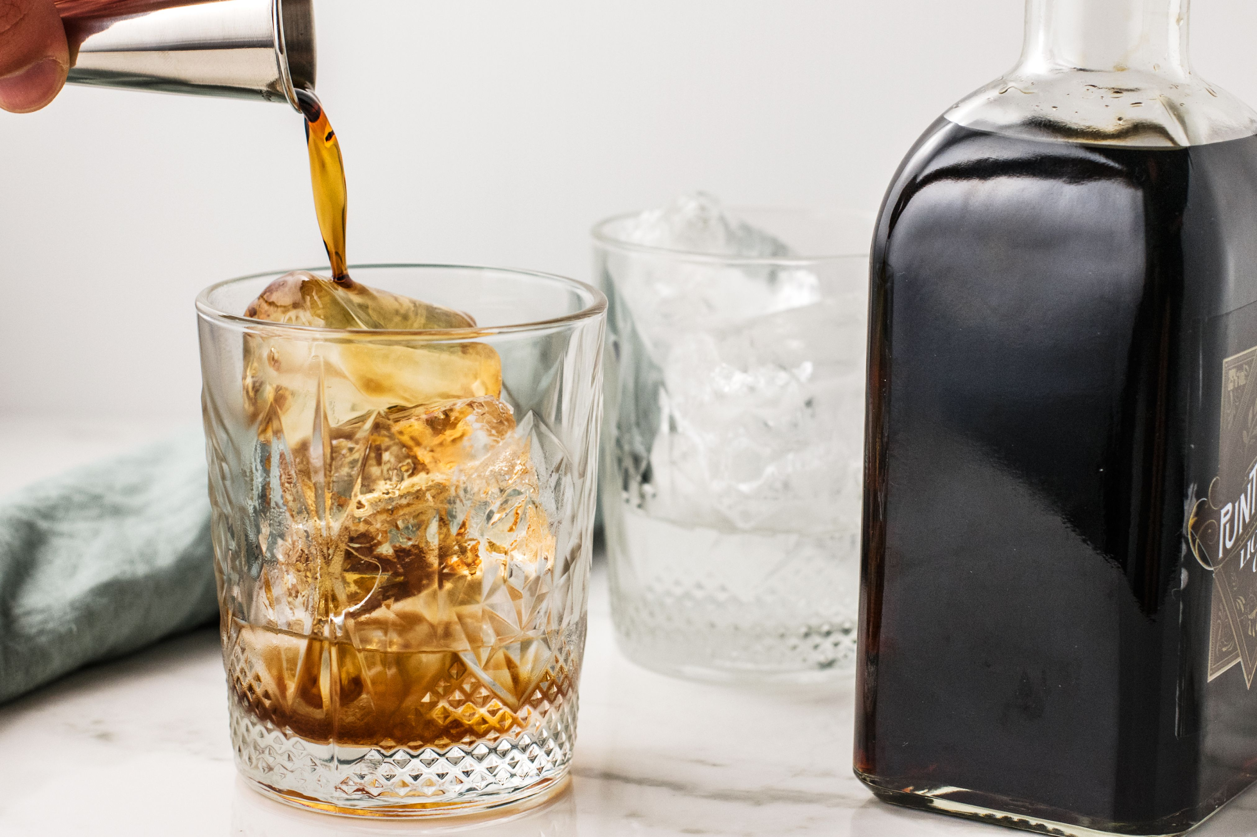 Vodka and coffee liqueur in an old-fashioned glass with ice