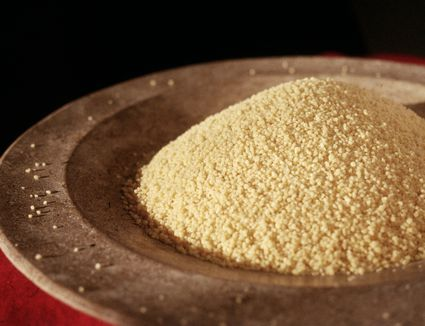 plain couscous in wooden bowl