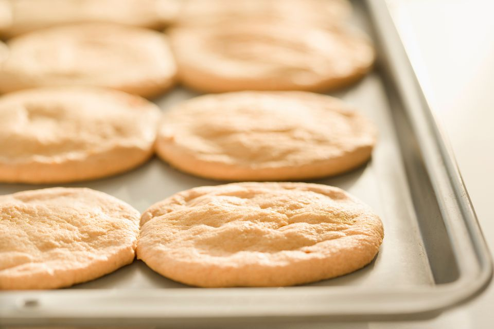Sugar cookies on baking sheet in oven
