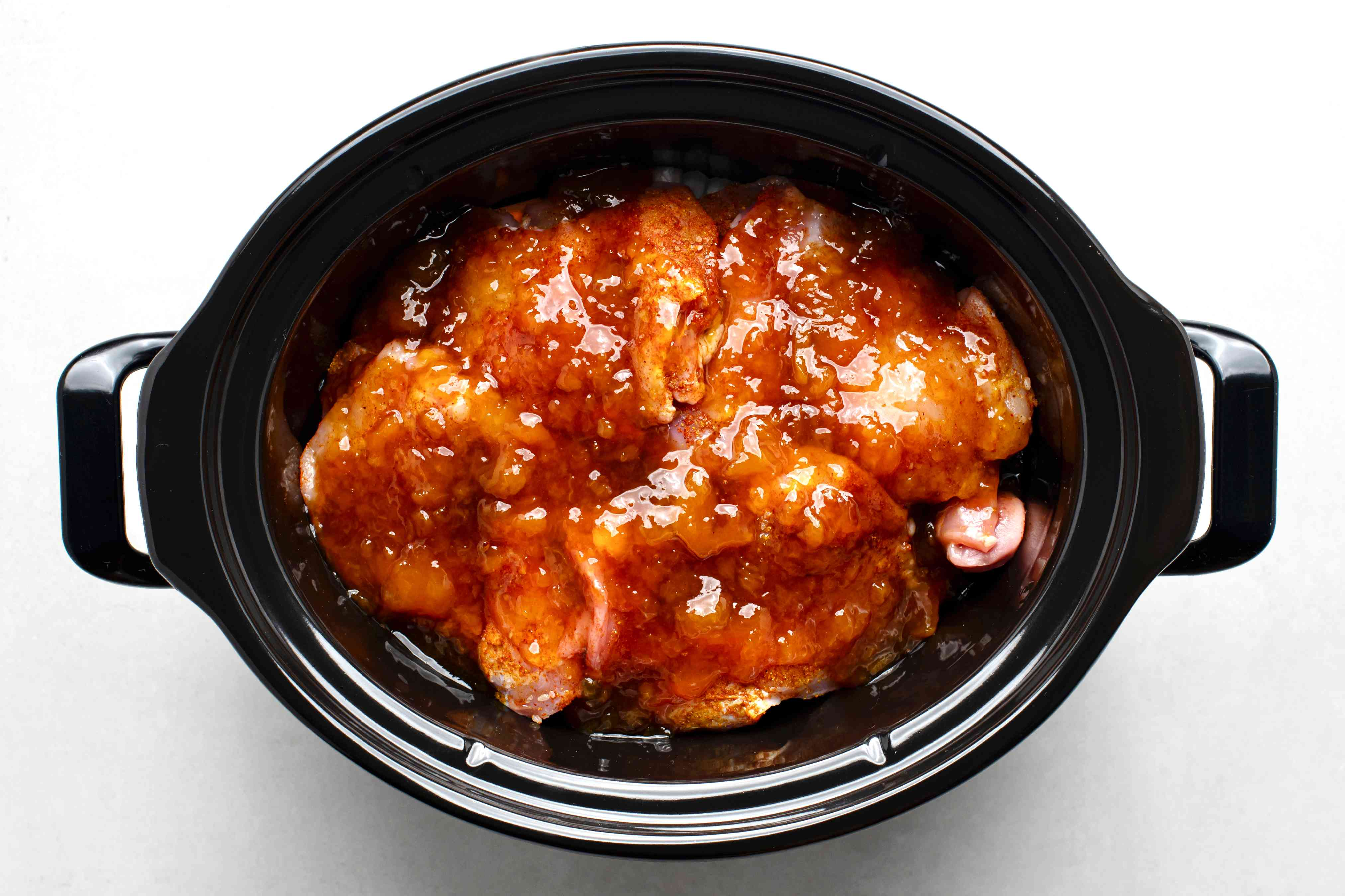 top the chicken with peach preserves, vinegar, and soy sauce