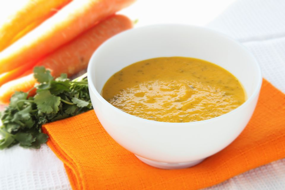 Carrot and coriander soup in bowl.