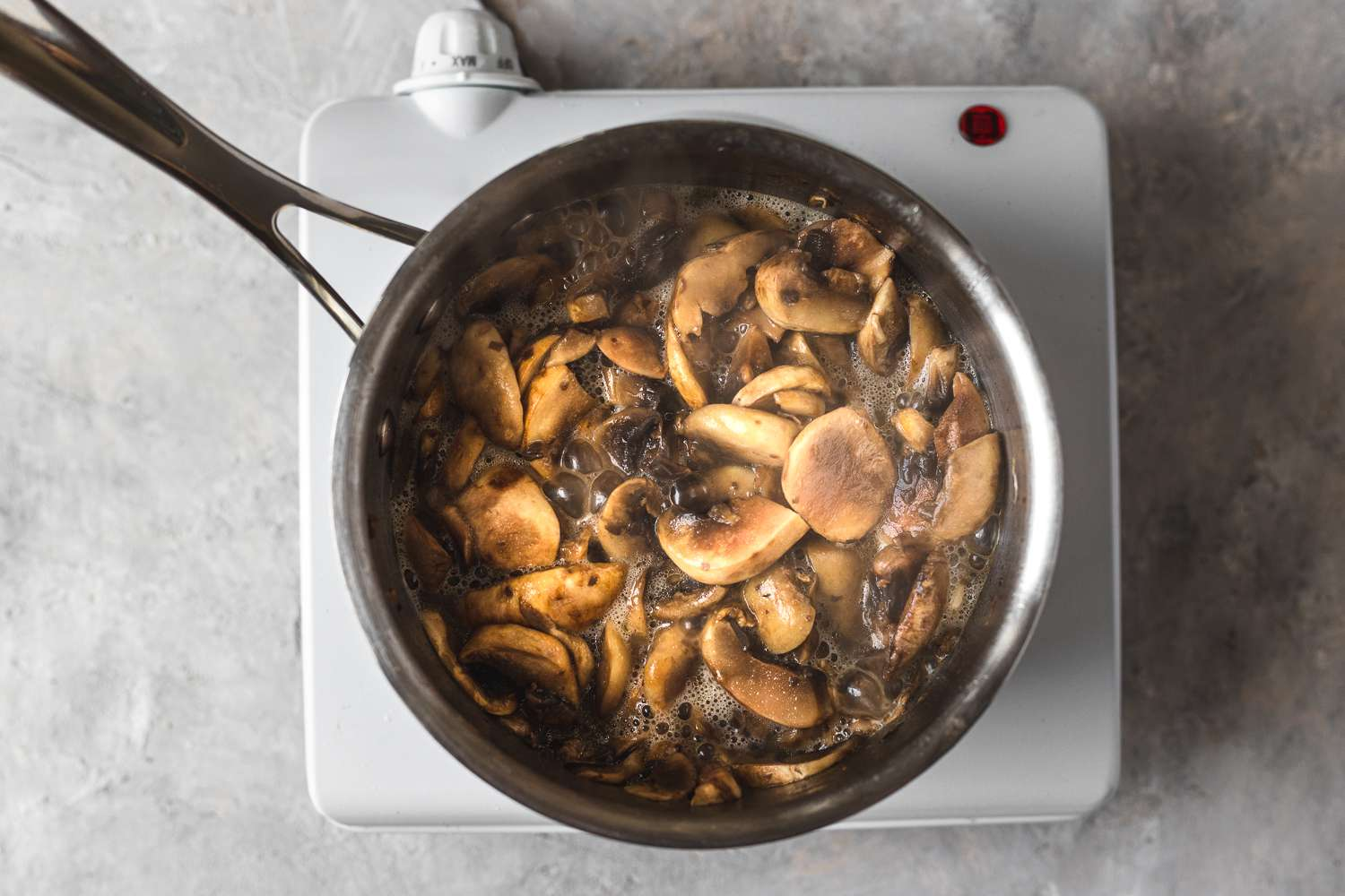 mushrooms and butter in a saucepan