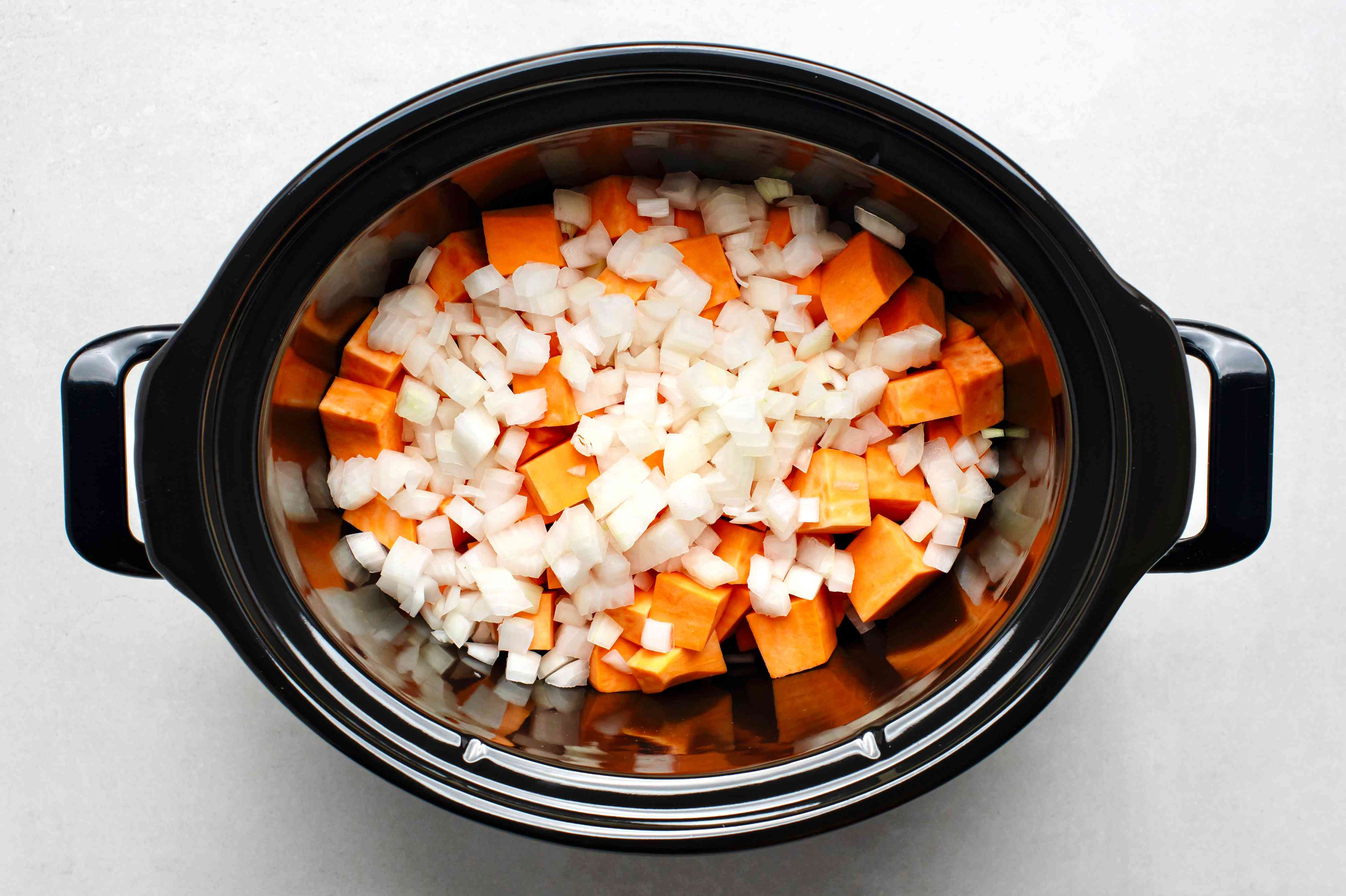 sweet potatoes and onions in a crockpot