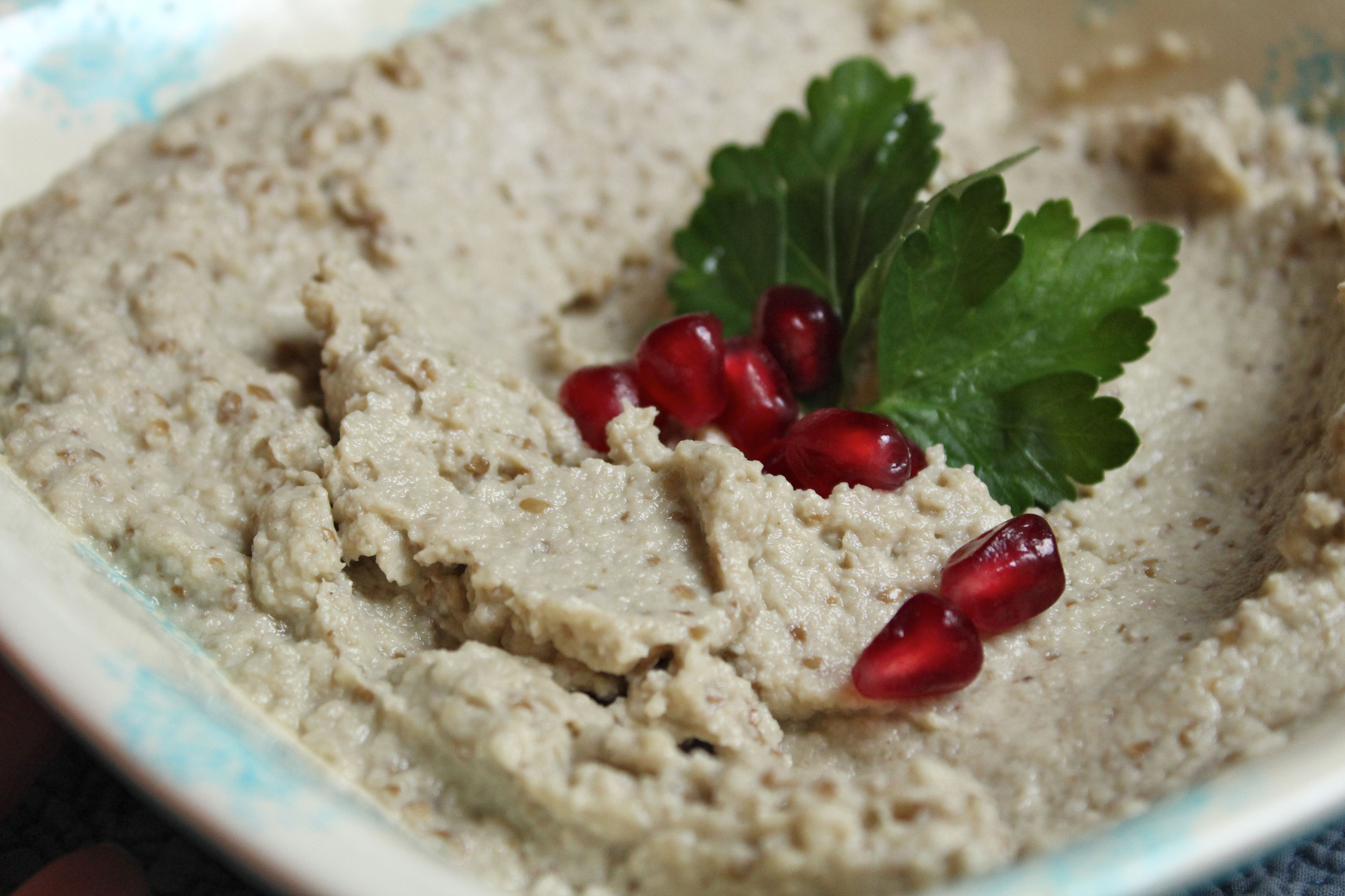Baba Ghanoush, garnished with pomegranate seeds and parsley