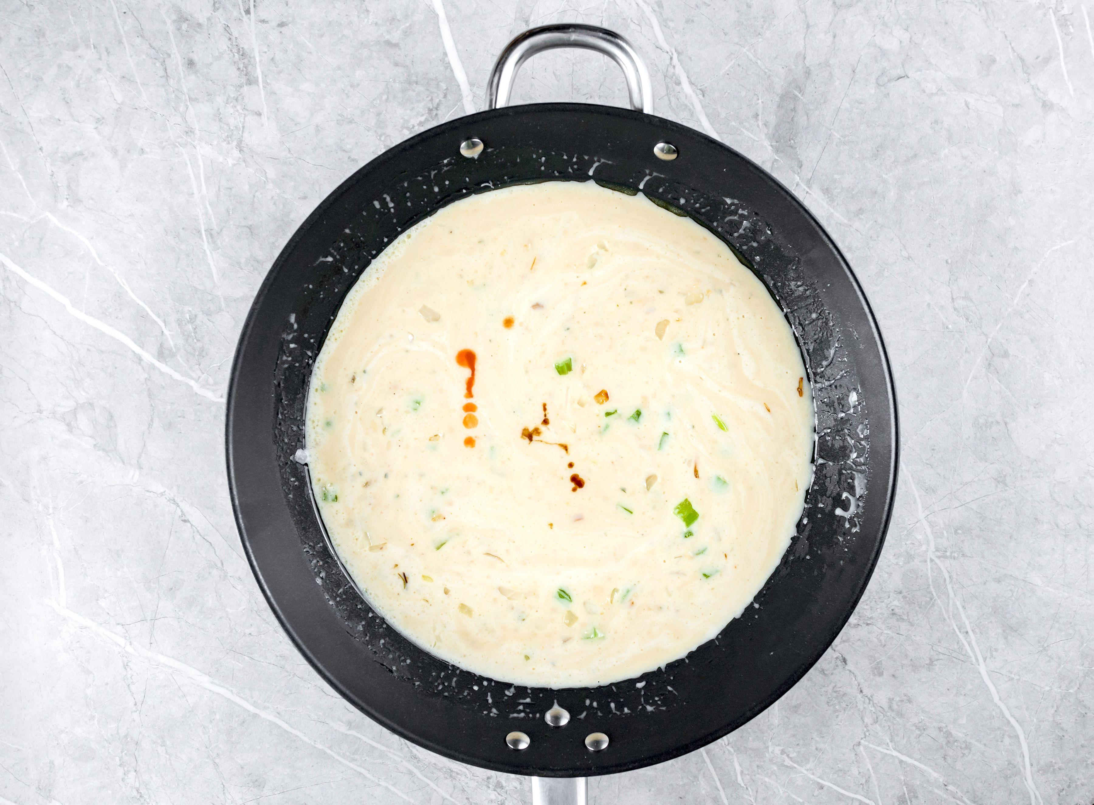 Simmering cream of mushroom soup, milk, Worcestershire, and Tabasco