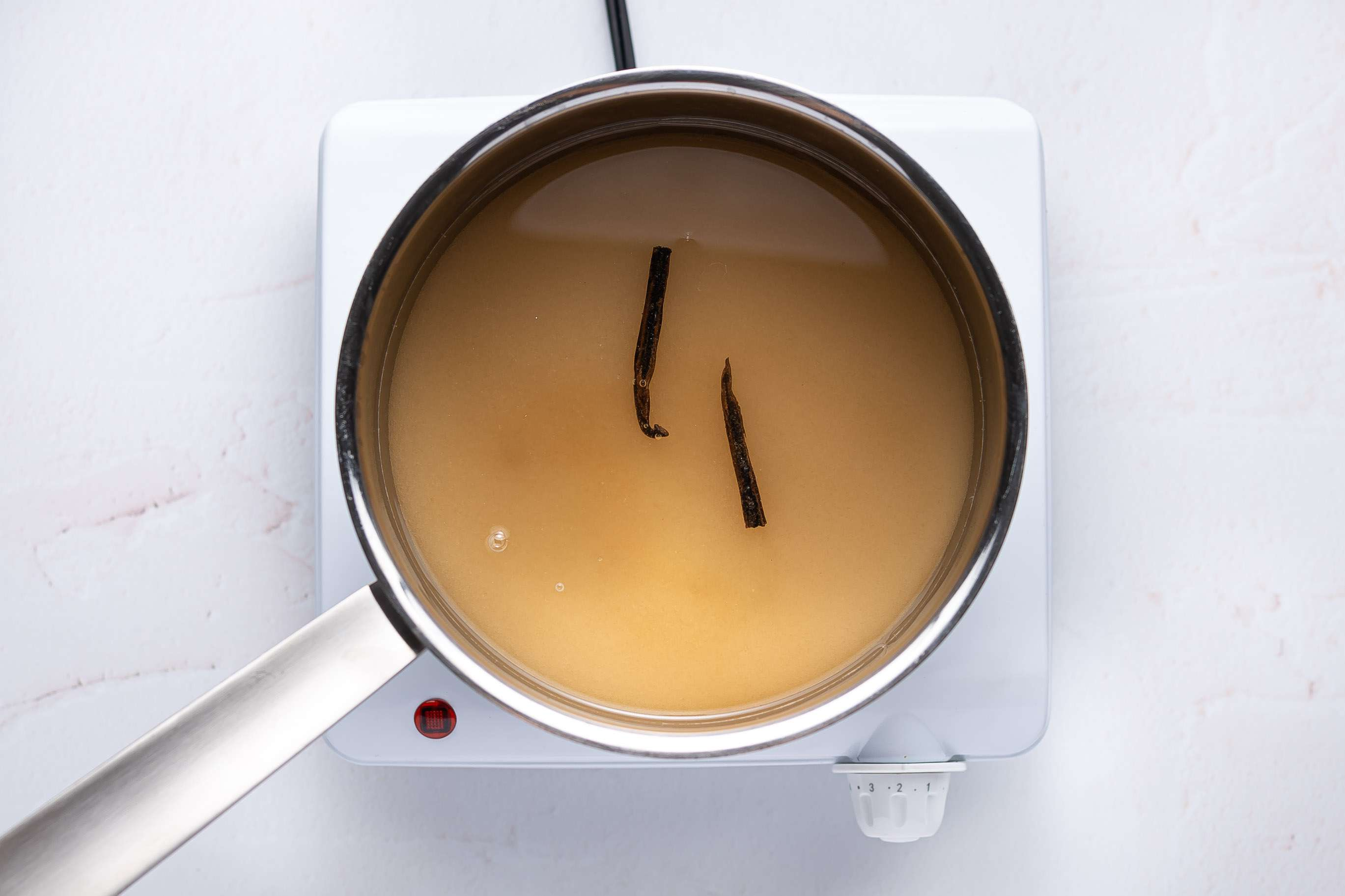 combine the sugar, water, and vanilla in a saucepan