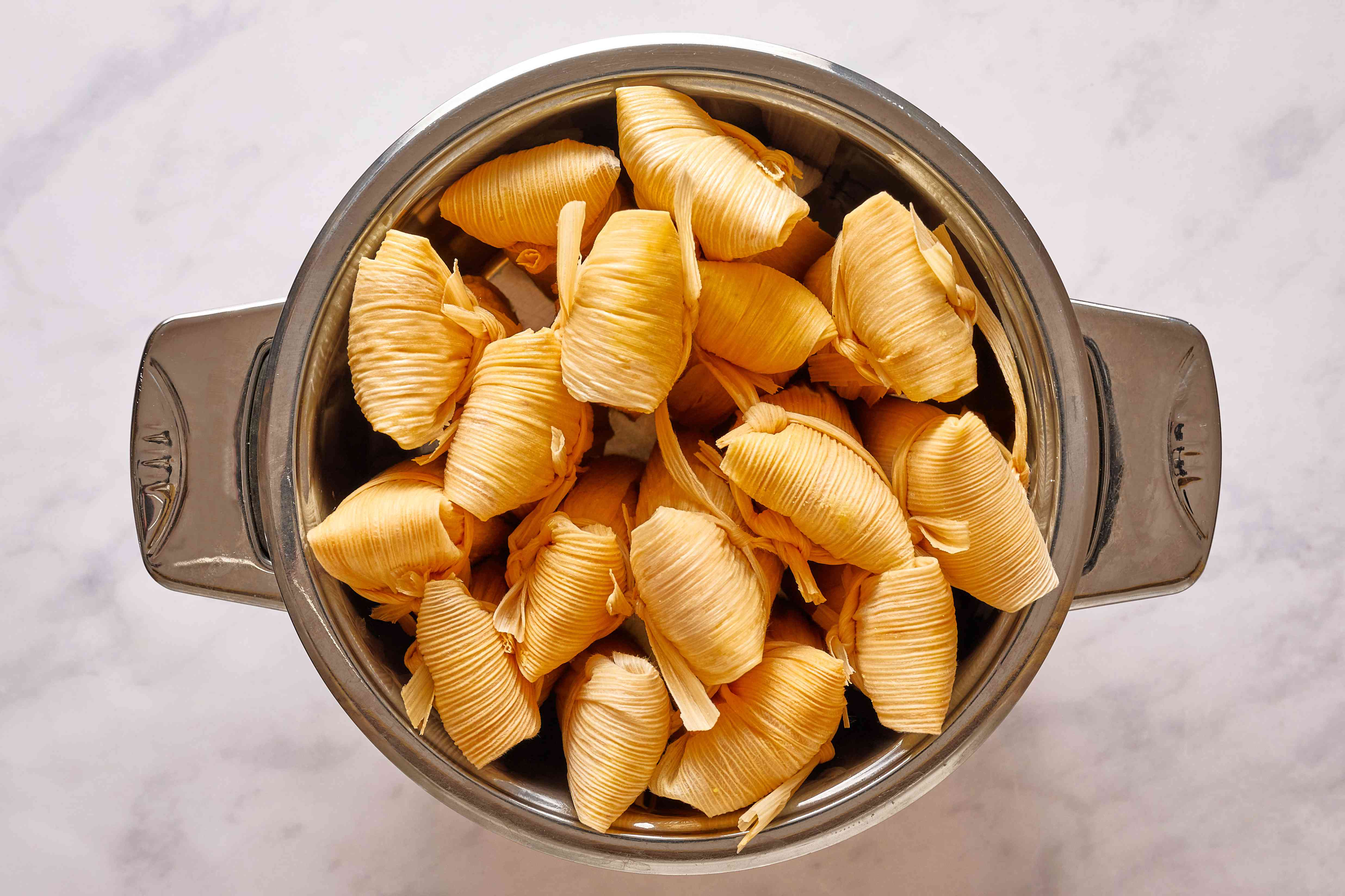 Set tamales upright in a steamer
