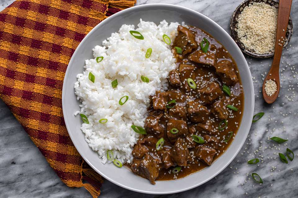 instant pot korean beef in a serving dish with rice