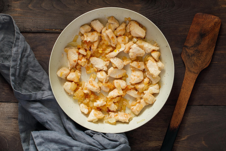 Add chicken pieces to skillet