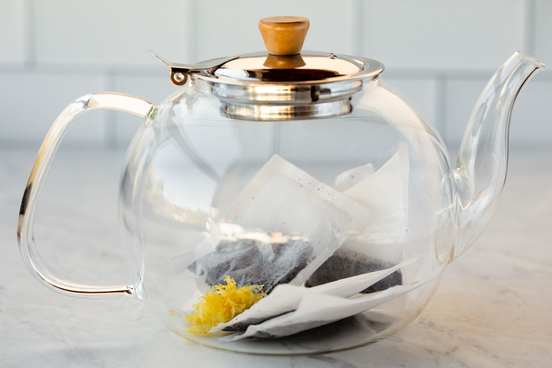 Add the tea bags, lemon peel, and lemon juice to a tea pot