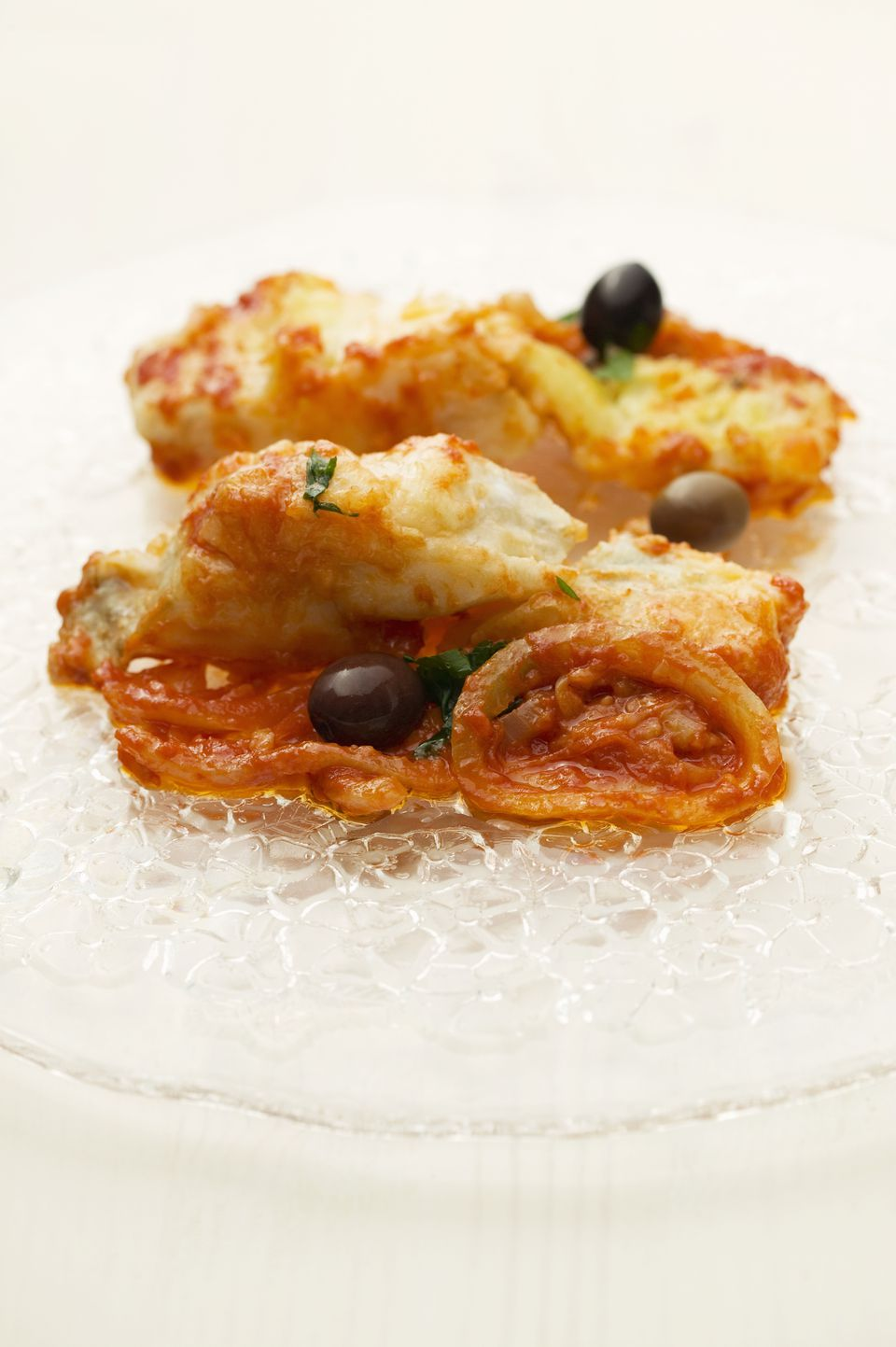 Fried cod fillet with tomato sauce and olives