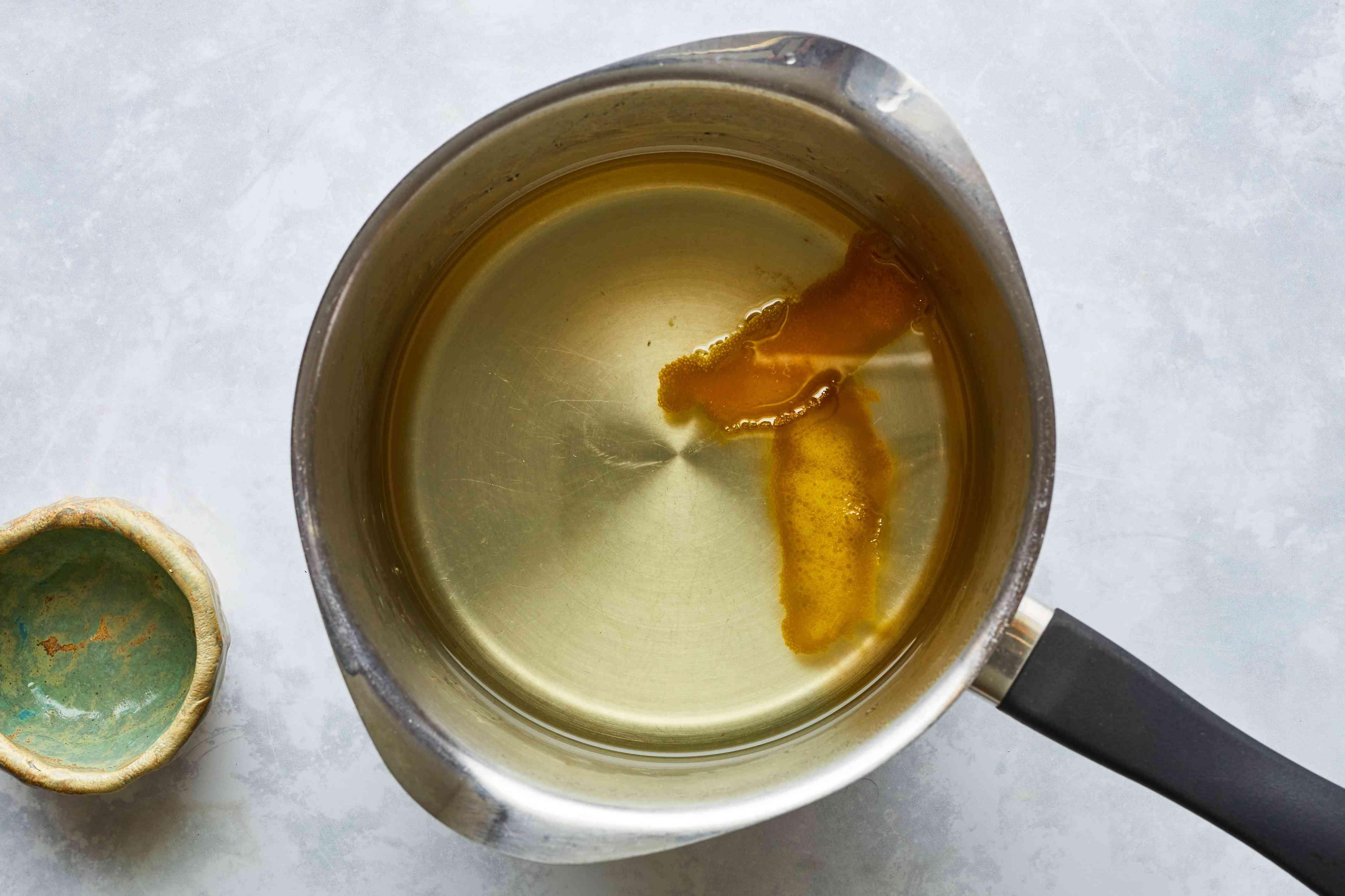 Water, sugar, orange zest, and lemon juice for revani cake syrup