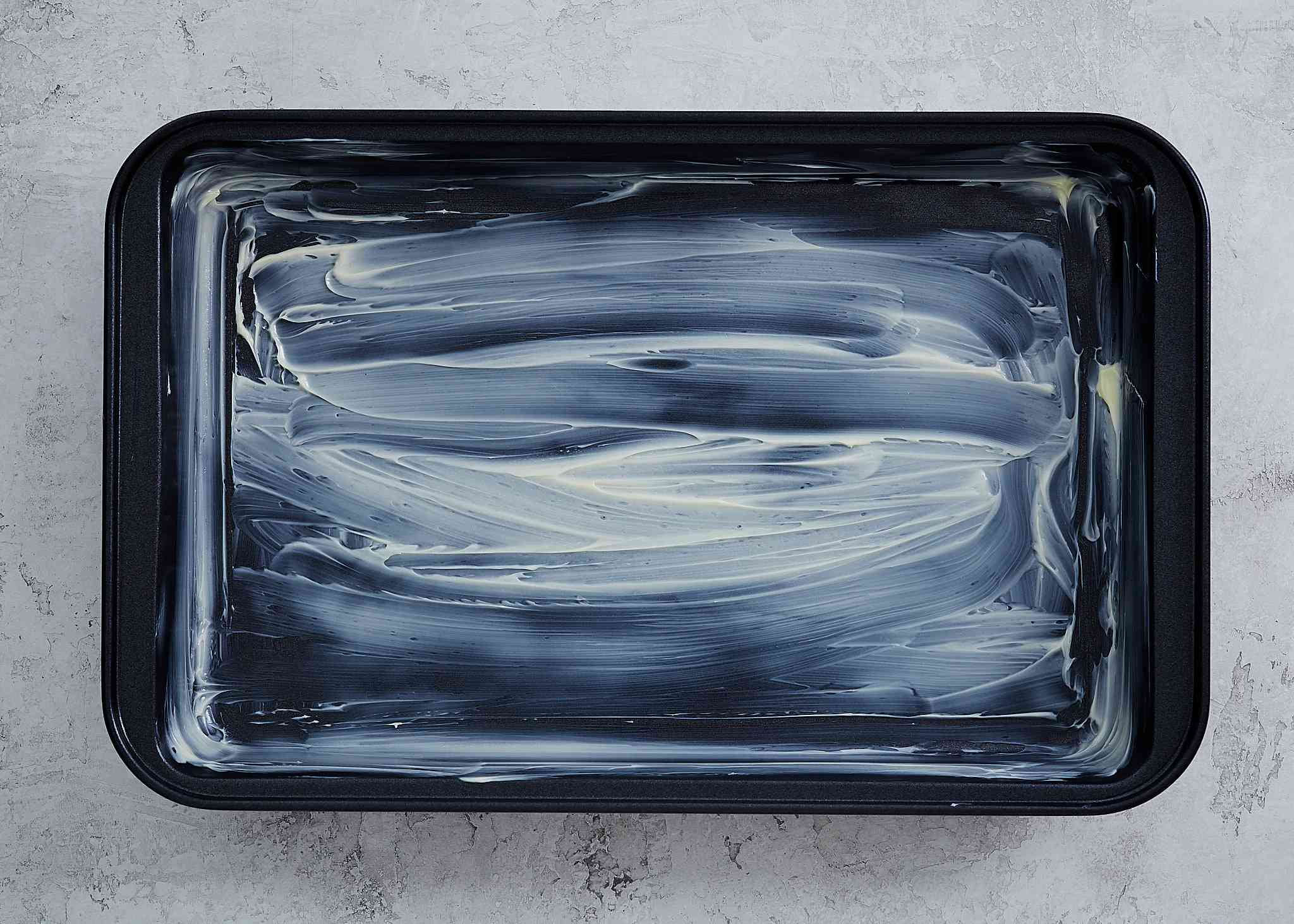 buttered / greased baking pan
