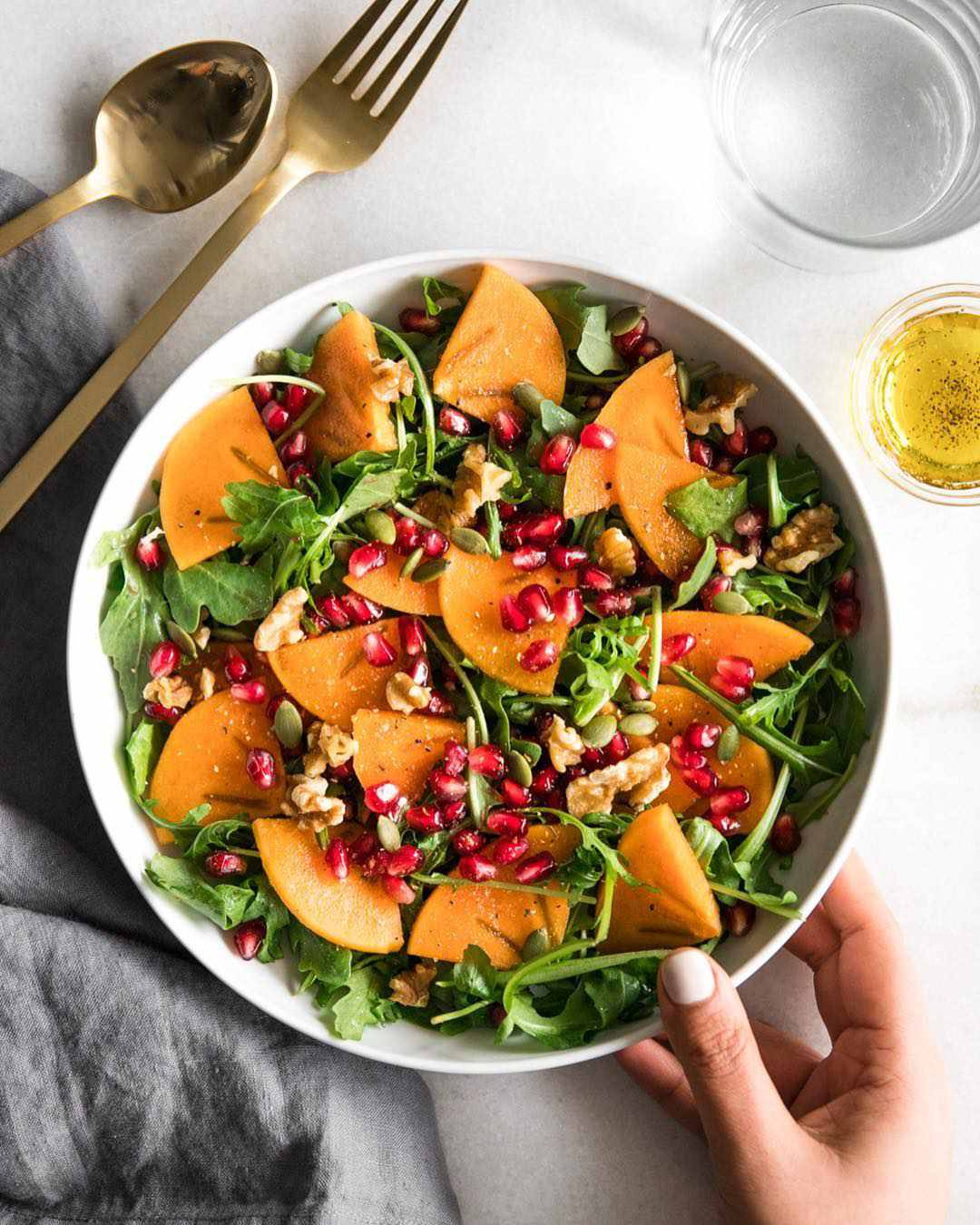 Arugula persimmon salad - @realandvibrant