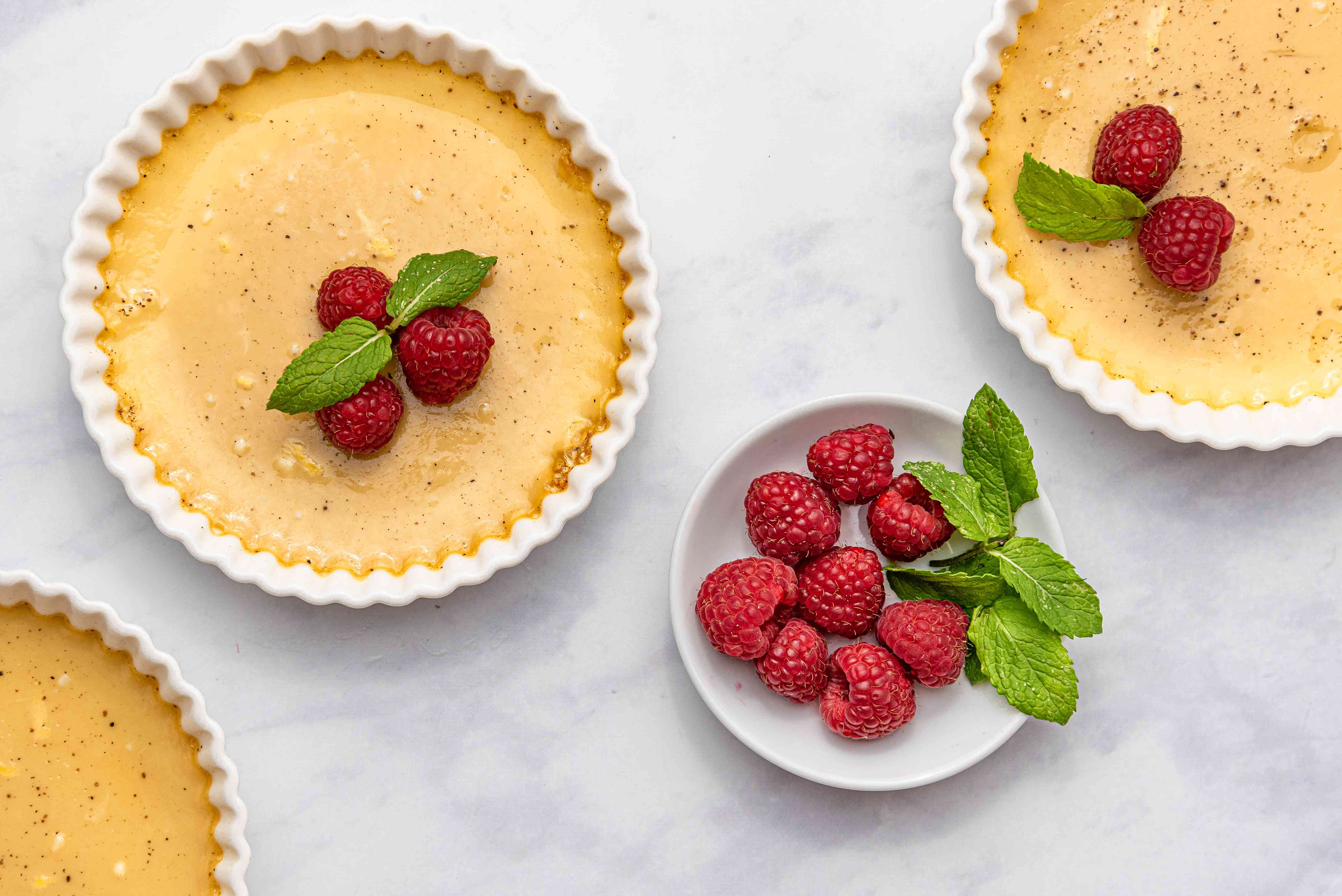Baked Custard topped with nutmeg and raspberries