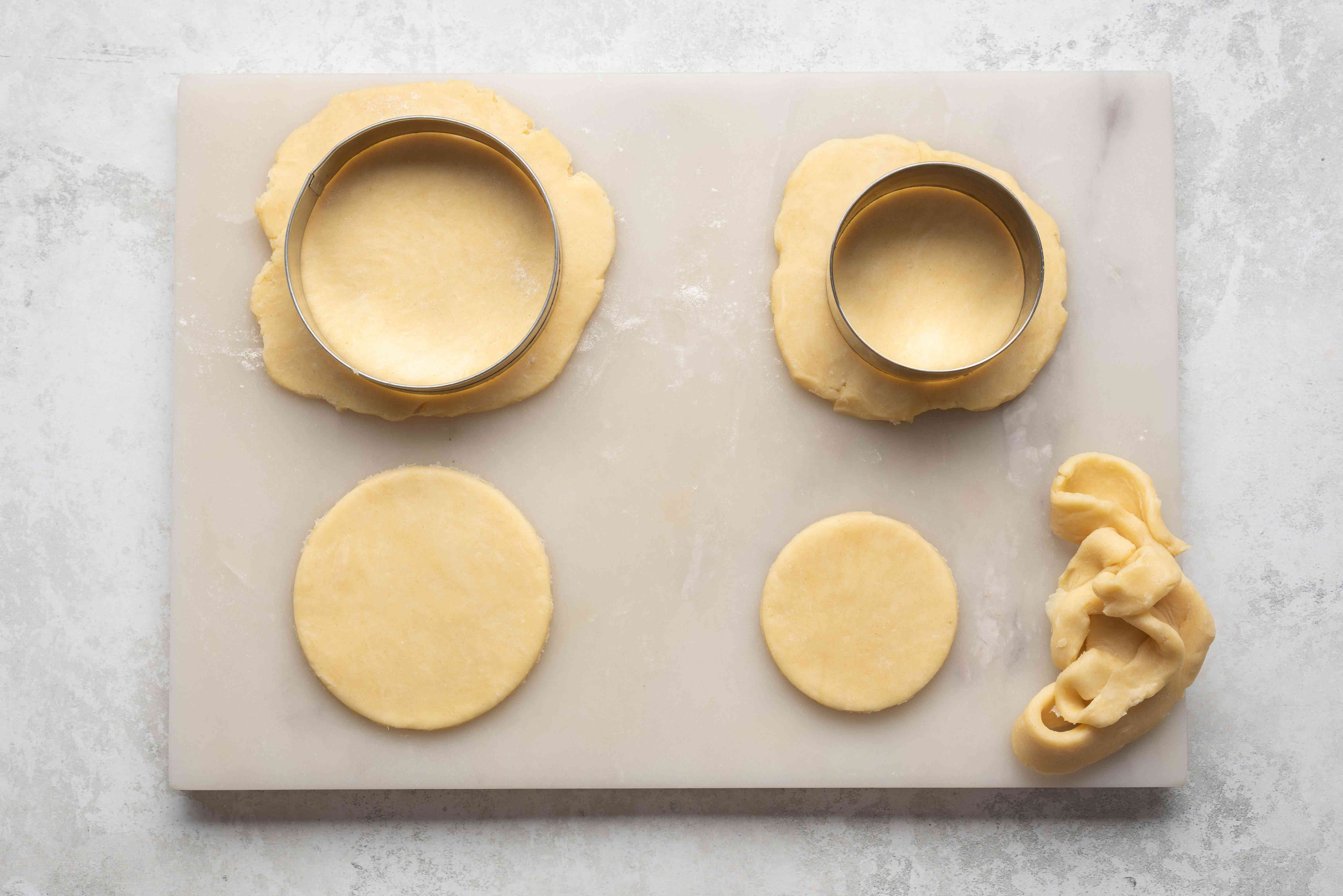 Trim excess crust dough with cookie cutters
