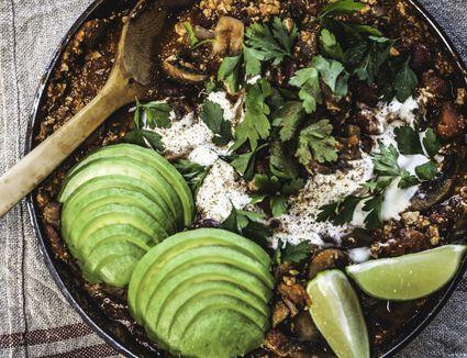 Mexican Mushroom, Tofu Chilli Pot to share with Avocado - stock photo