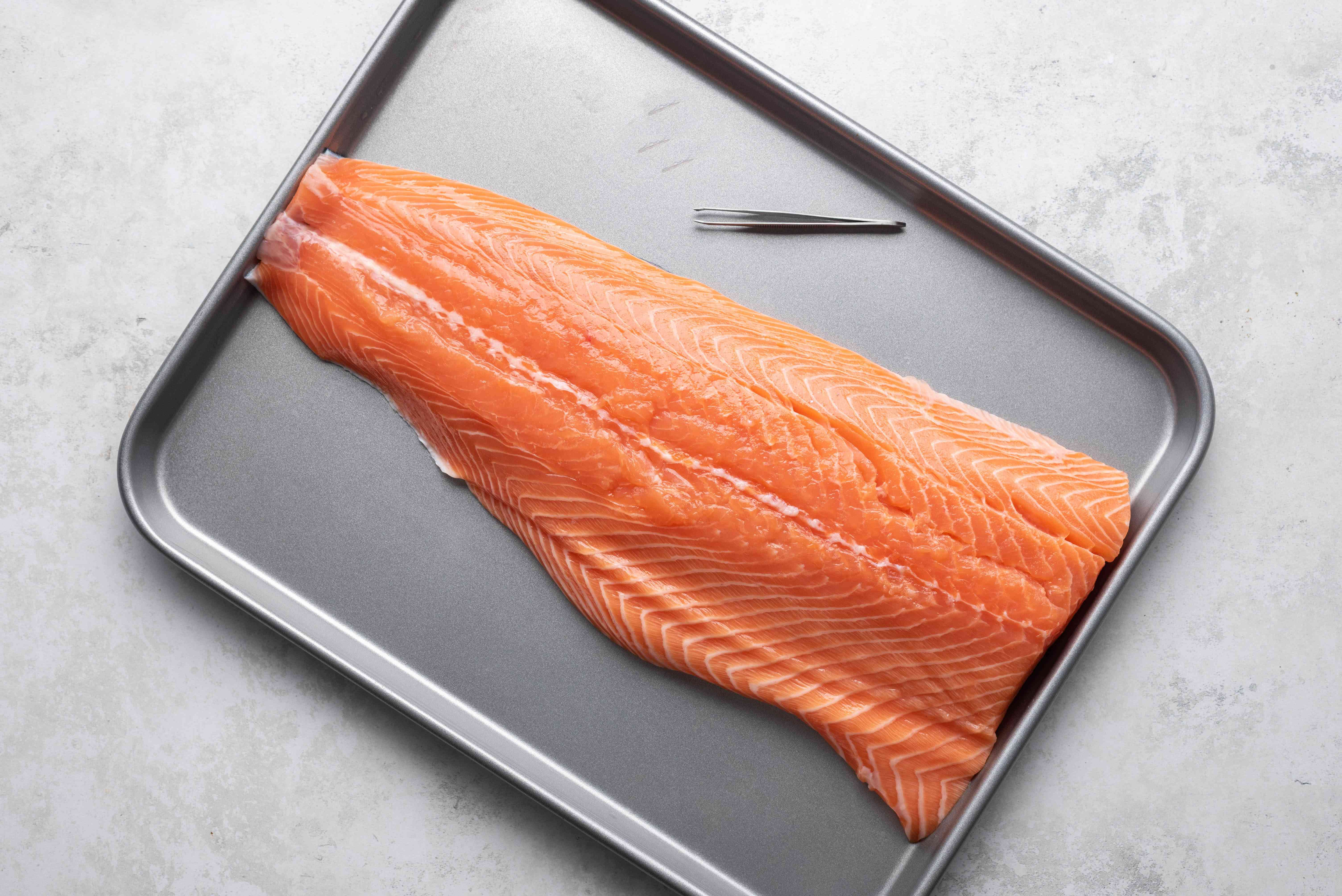 Remove the pin bones from the salmon