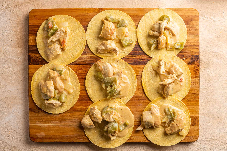 chicken mixture on top of tortillas