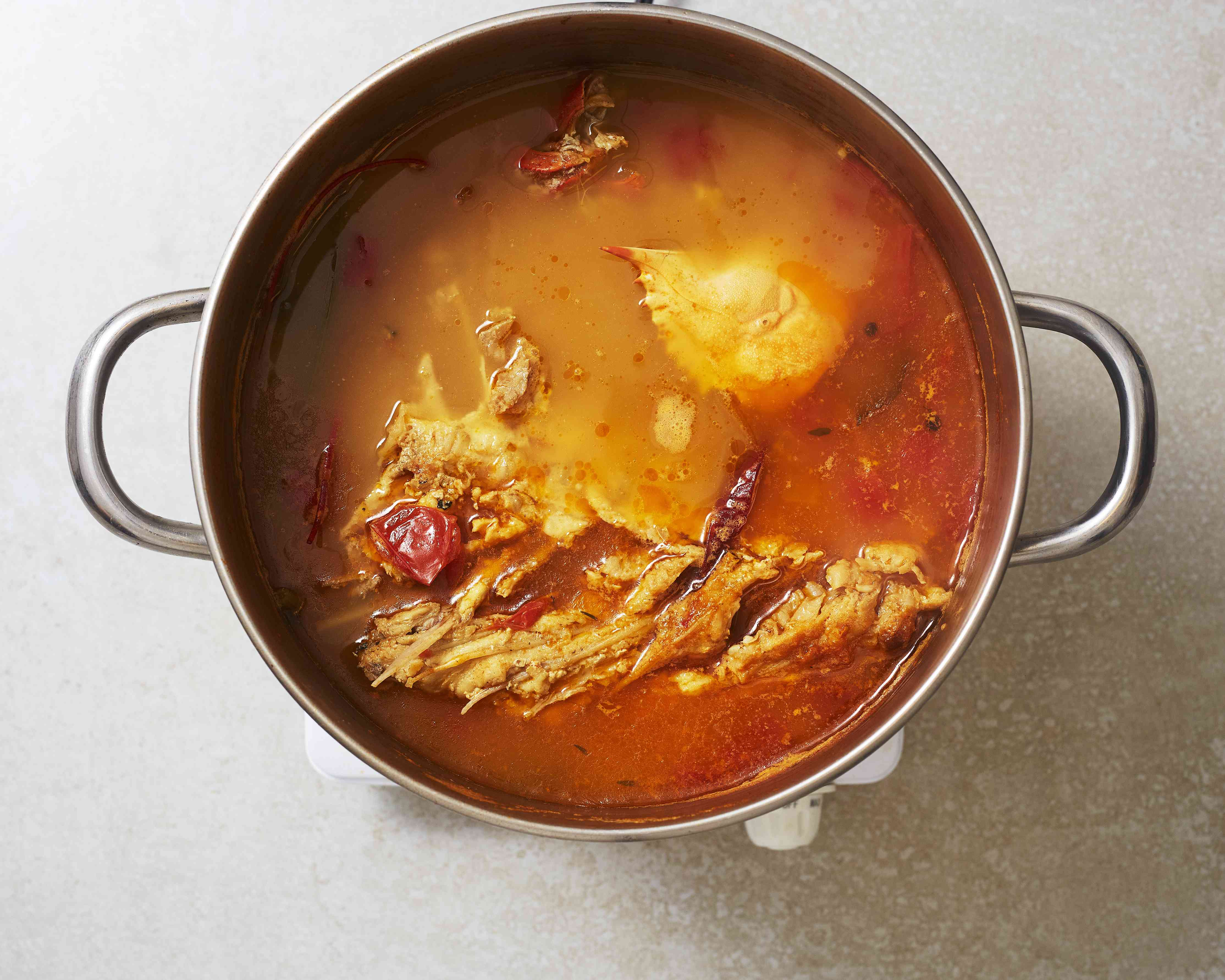 cook the fish soup in the pot