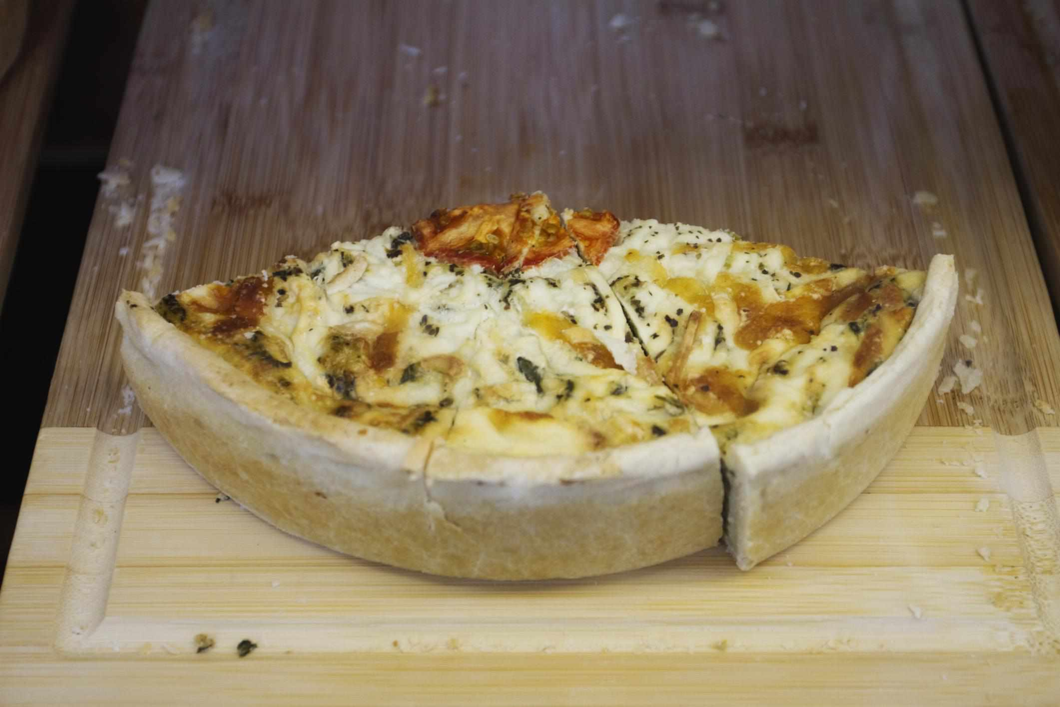Spinach Quiche on wooden board