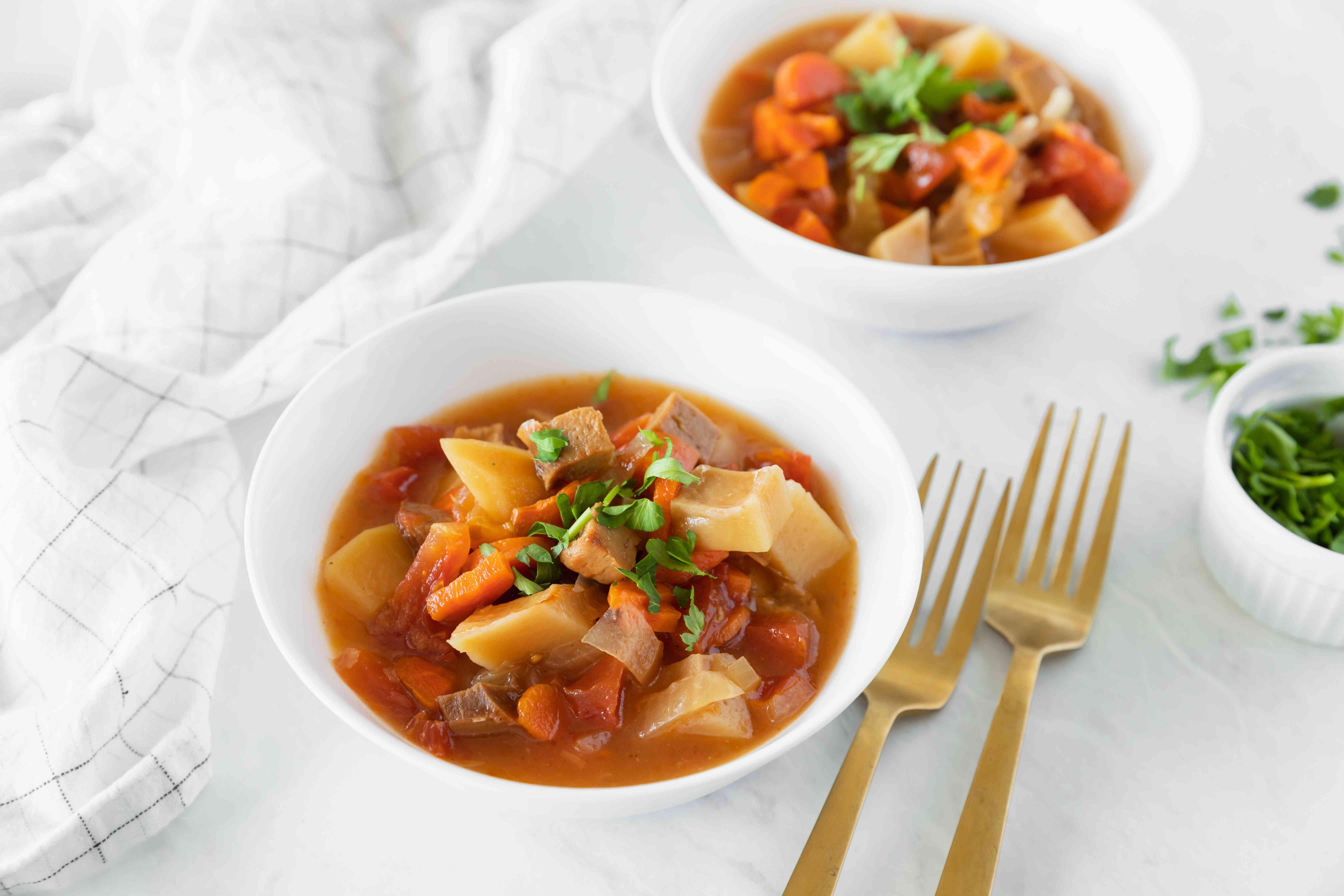 Crock pot vegetarian stew in white bowls