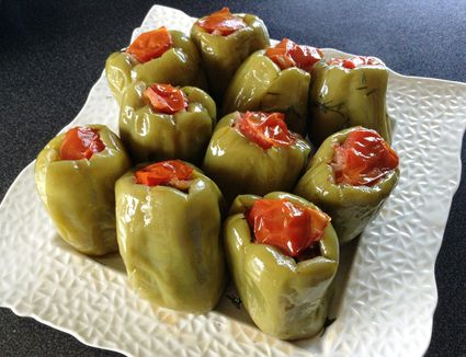 green peppers stuffed with rice topped with tomato skin