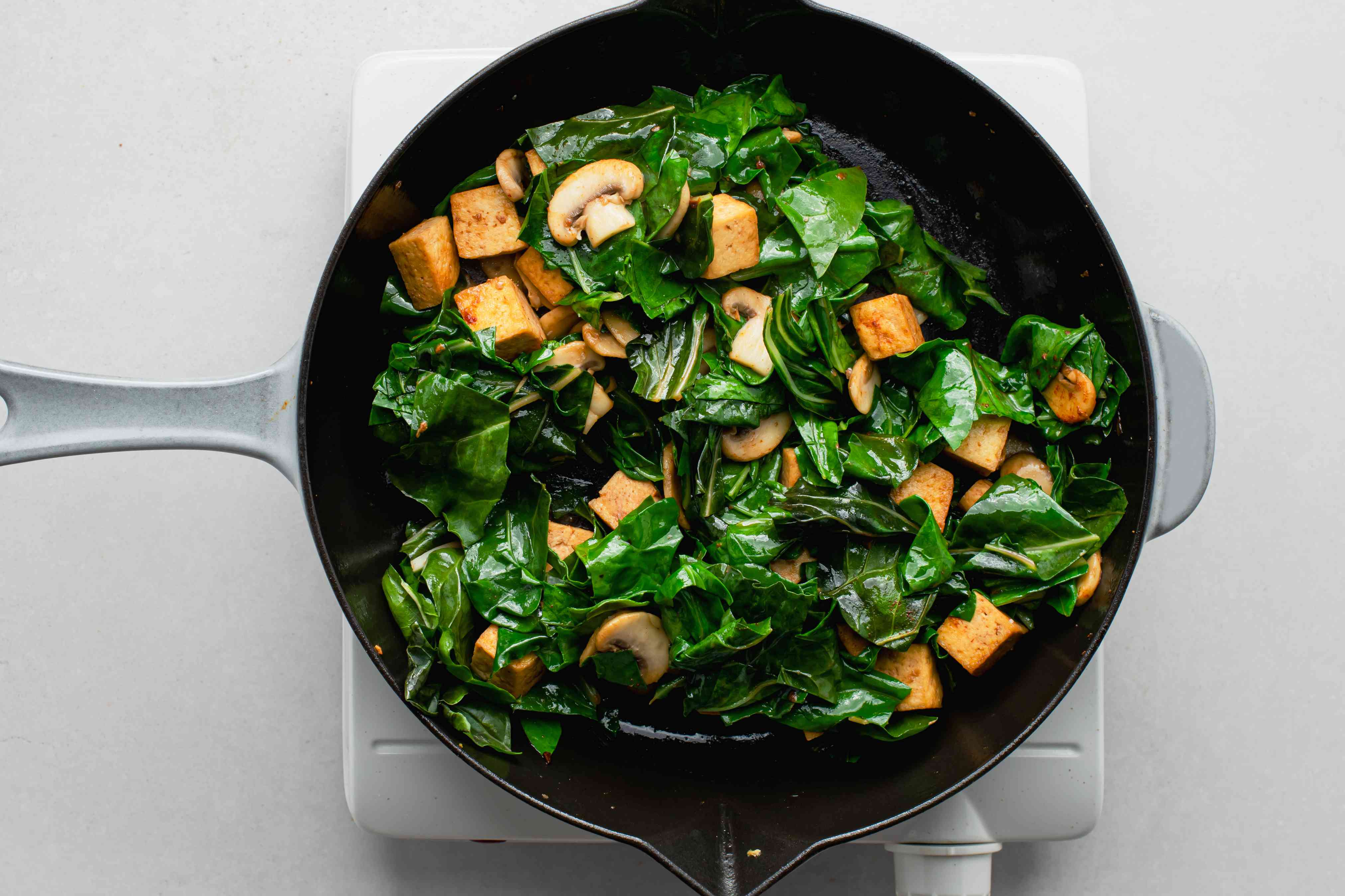 Swiss Chard, mushrooms and tofu in a skillet