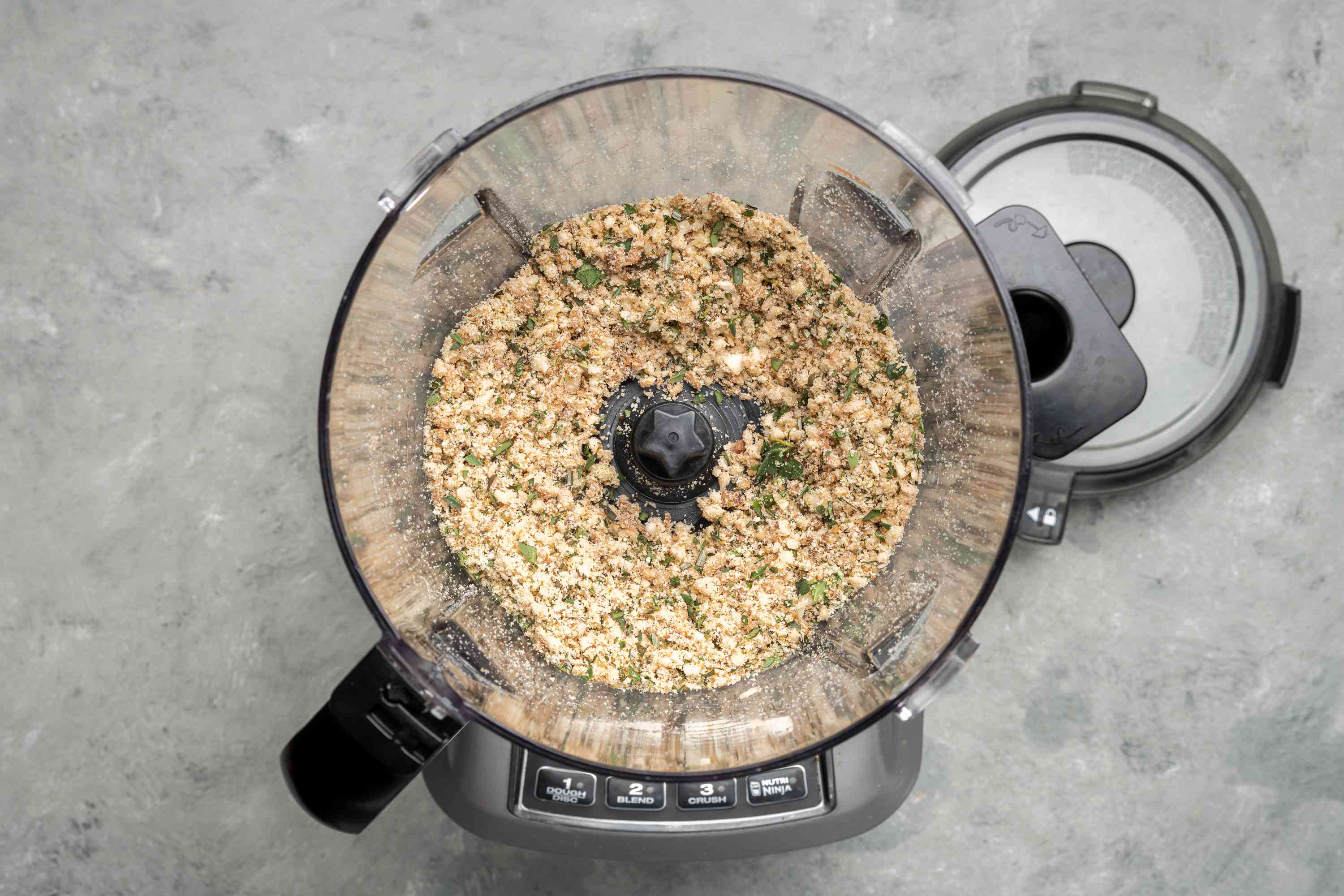 Herb and breadcrumb mixture in a food processor