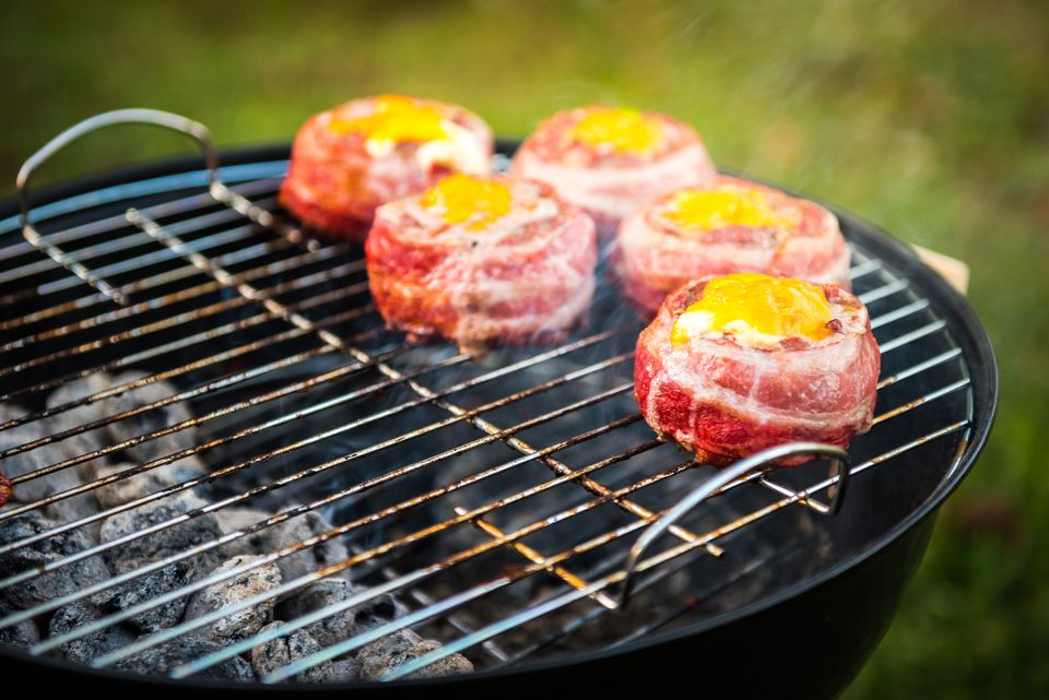 Hamburgers stuffed with cheese on the grill