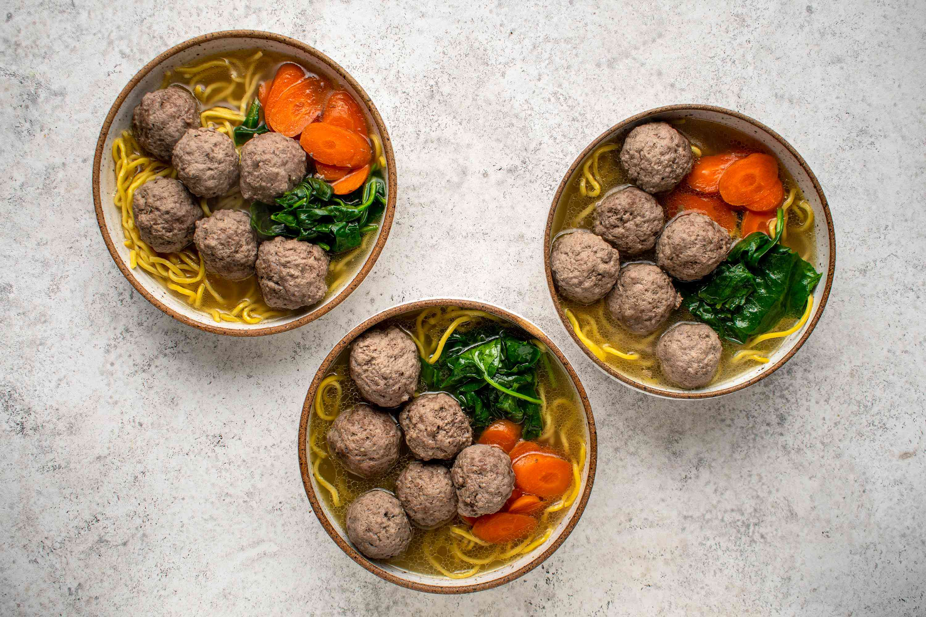 Ladle the hot soup and meatballs directly into the bowls