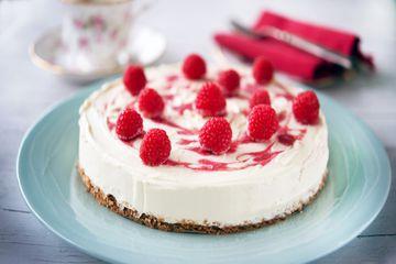 White chocolate cheesecake topped with fresh raspberries