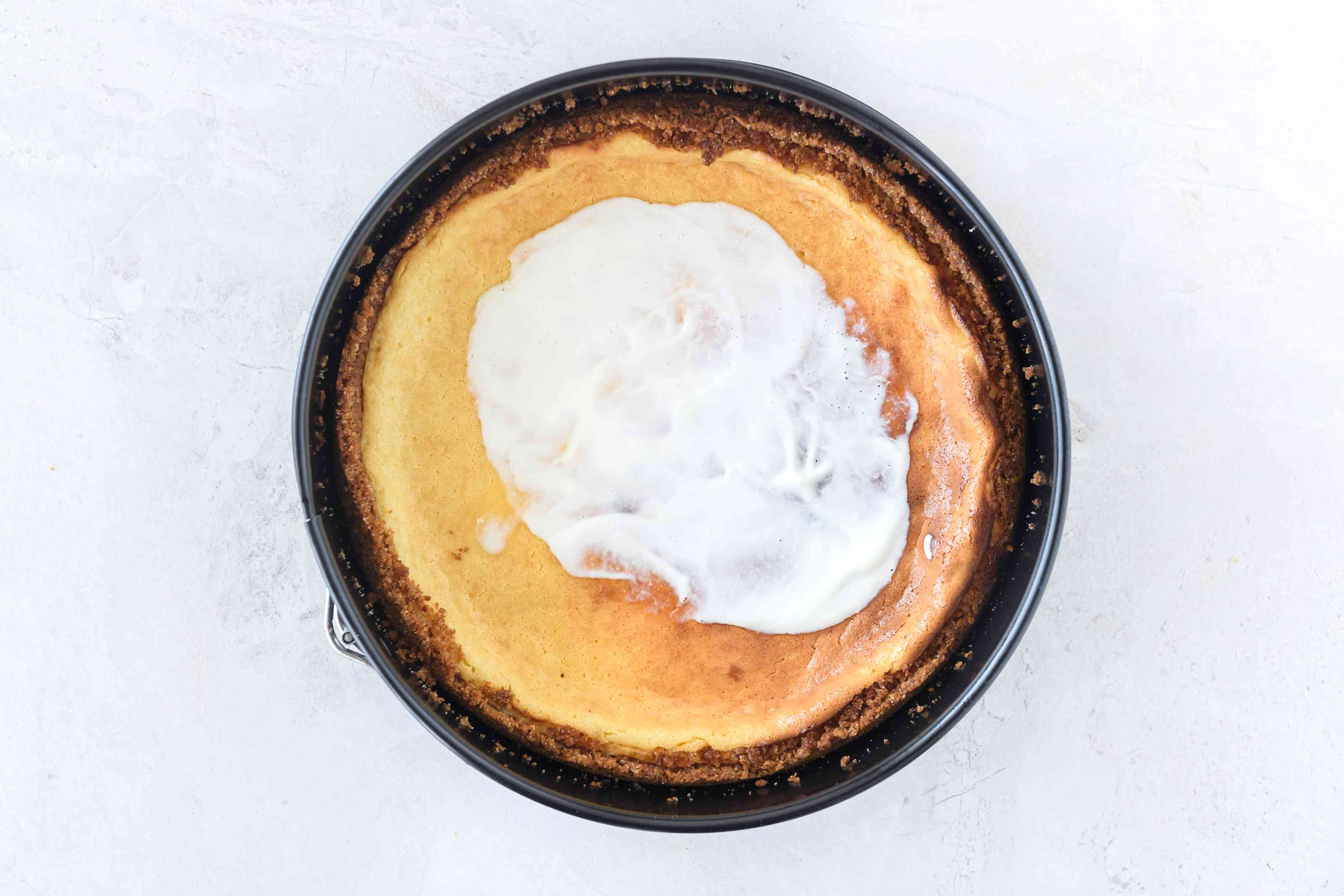 Dairy-free sour cream on dairy-free cheesecake