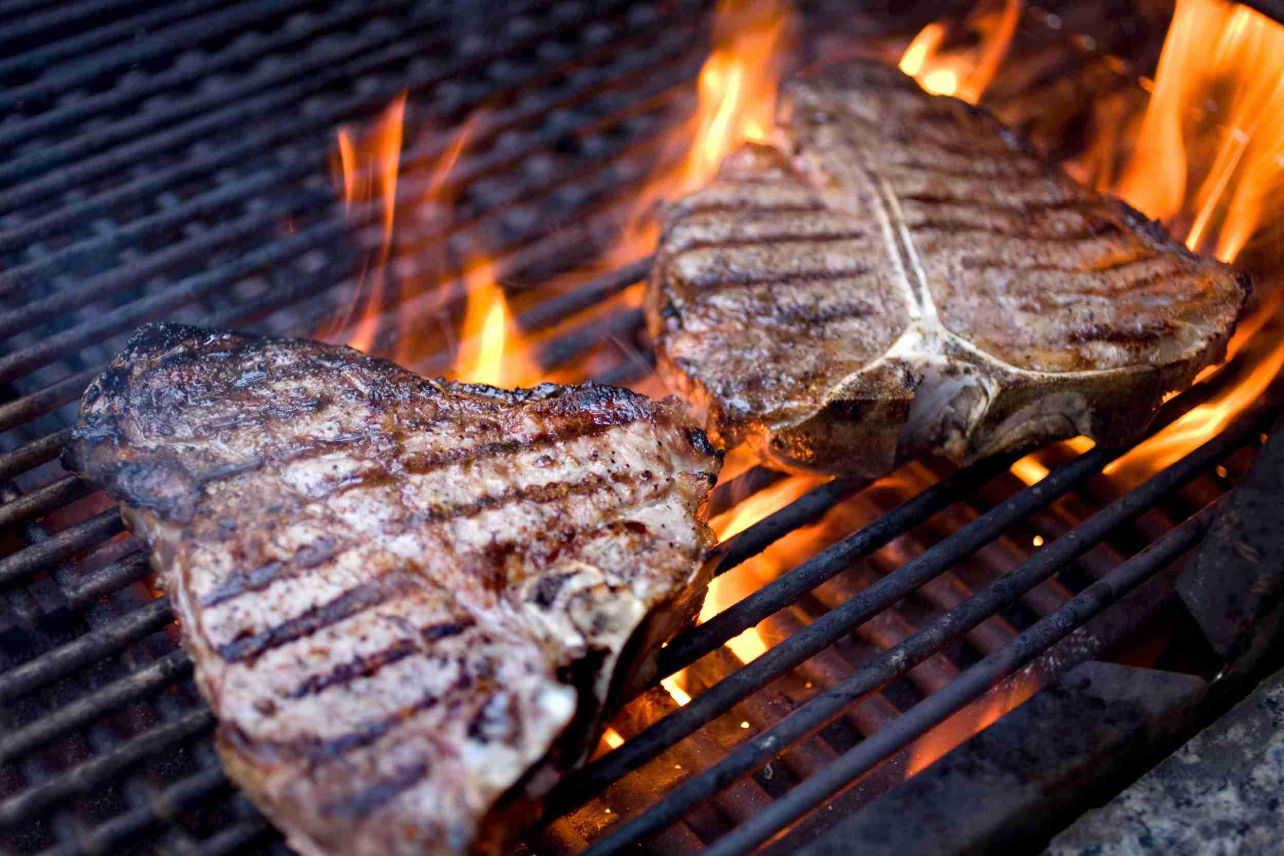 T-bone steaks on the grill.